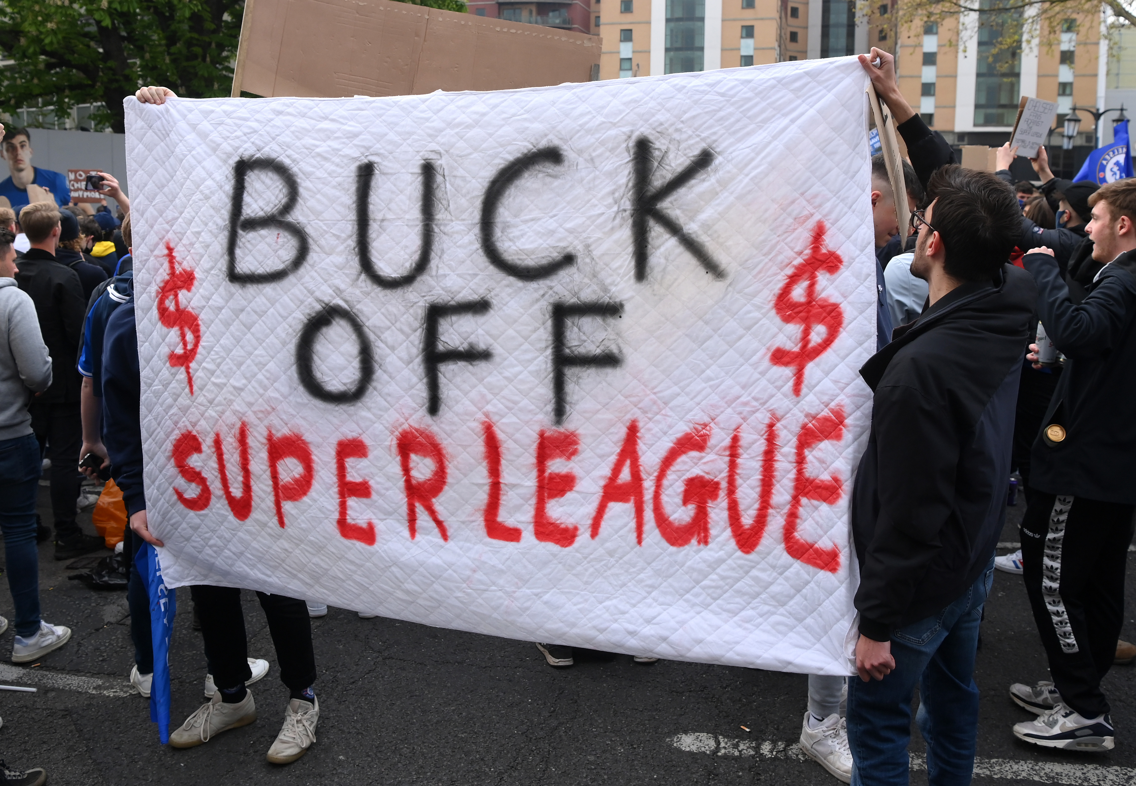 Chelsea fans protest against the newly proposed European Super League prior to the Premier League match between Chelsea and Brighton at Stamford Bridge on April 20, 2021 in London, England