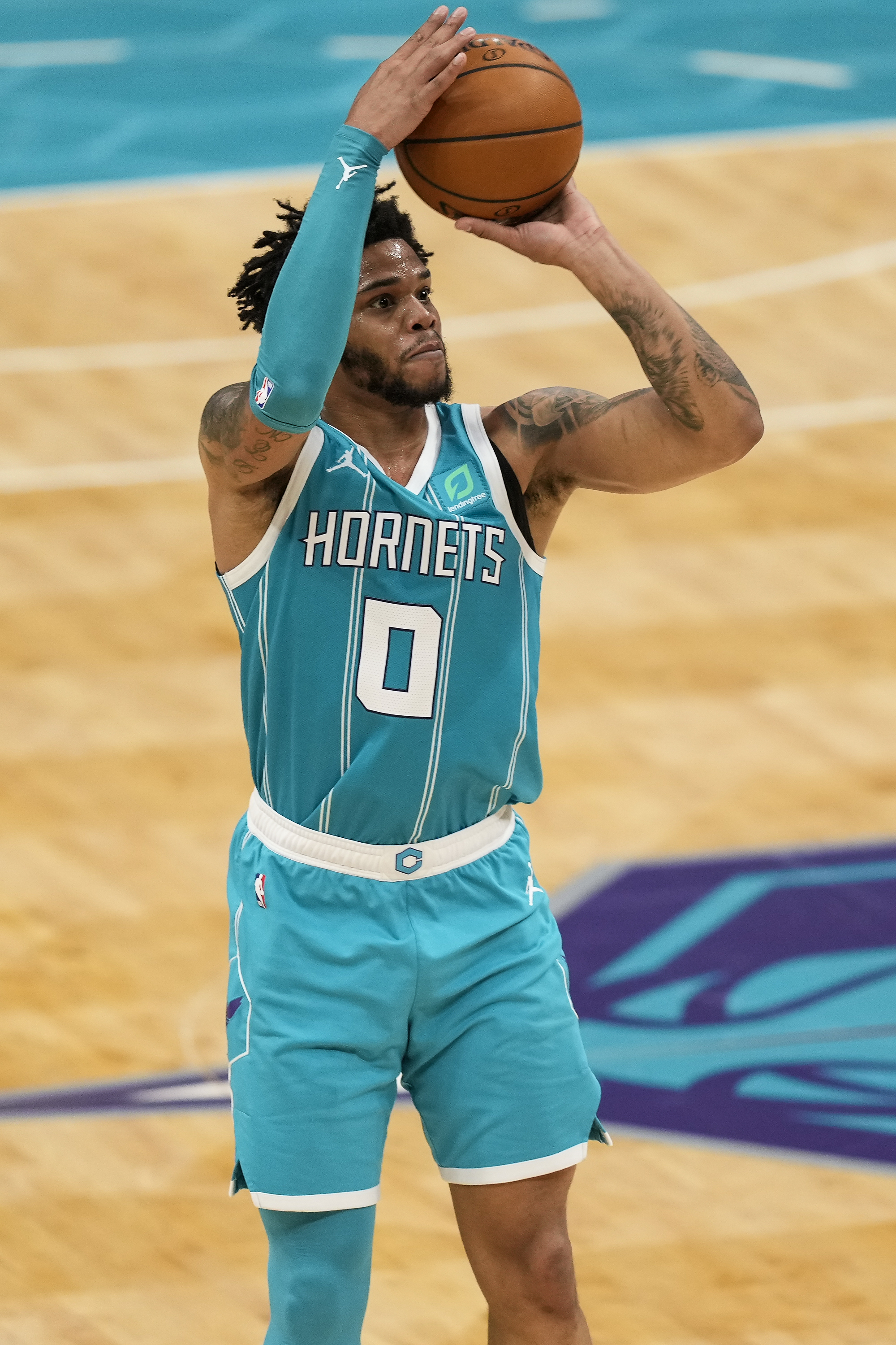 Charlotte Hornets forward Miles Bridges shoots three against the Portland Trail Blazers during the second half at the Spectrum Center.