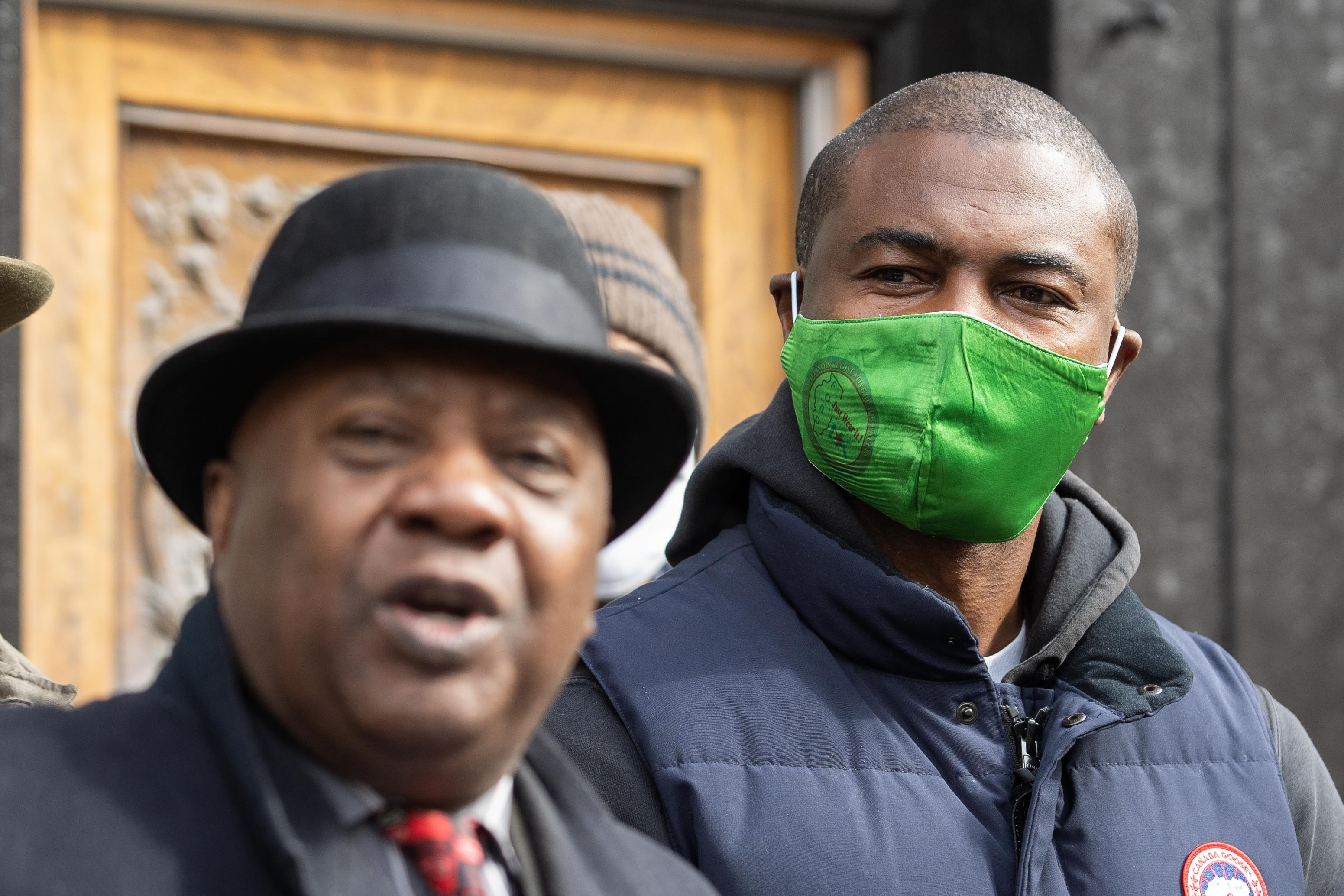State Rep. La Shawn Ford listens as former state Sen. Ricky Hendon speaks during a press conference outside Nature's Care West Loop in the West Town neighborhood, where cannabis equity advocates announced the introduction of House Bill 327, Tuesday morning, March 16, 2021. | Pat Nabong/Sun-Times
