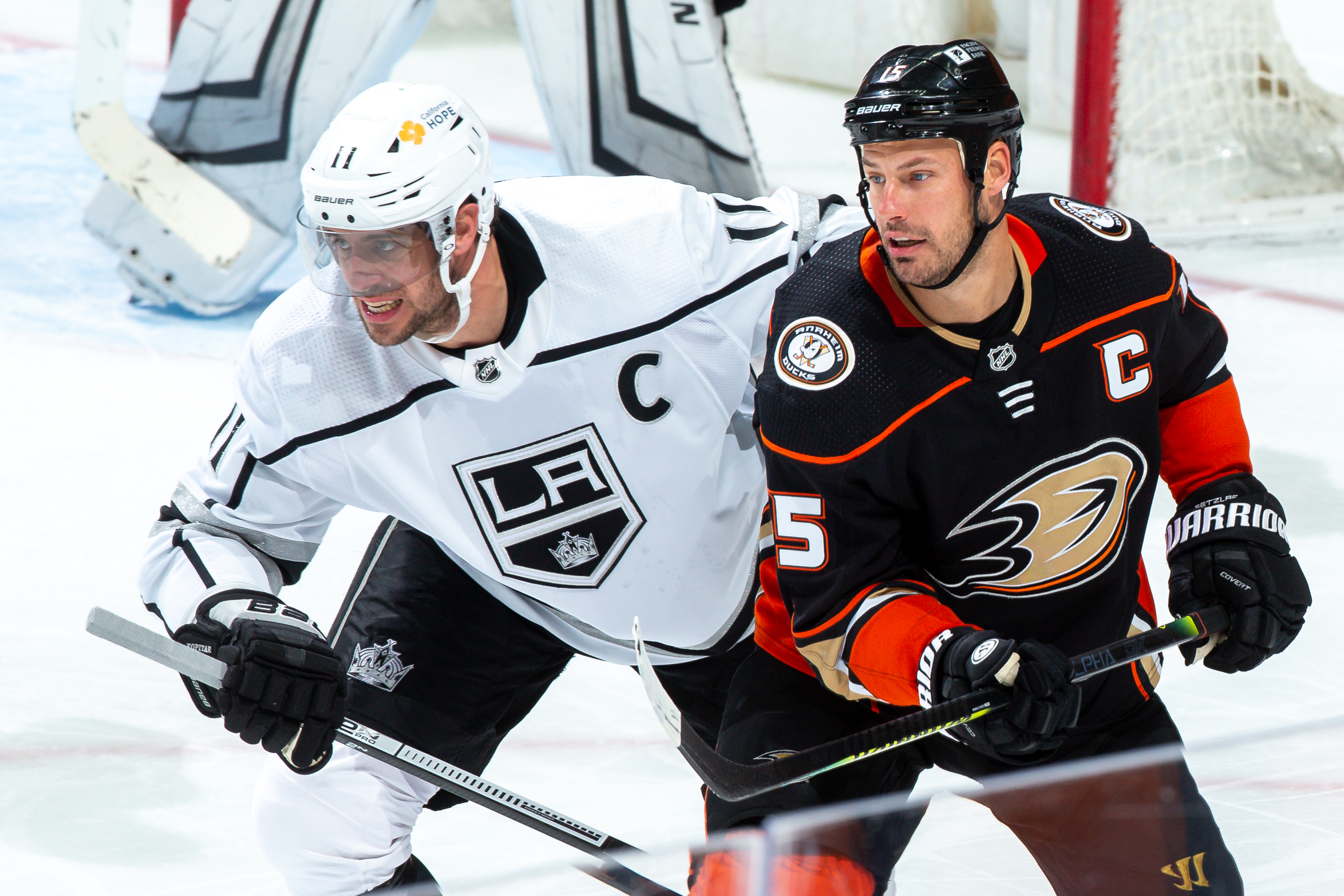 Anze Kopitar #11 of the Los Angeles Kings and Ryan Getzlaf #15 of the Anaheim Ducks battle for position during the third period of the game at Honda Center on March 10, 2021 in Anaheim, California.
