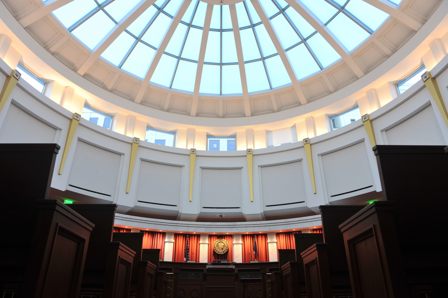Photo shows half the ale blue glass dome and the upper level of the Colorado Supreme Court chambers at the Ralph Carr Judicial Center in Denver, Colorado.