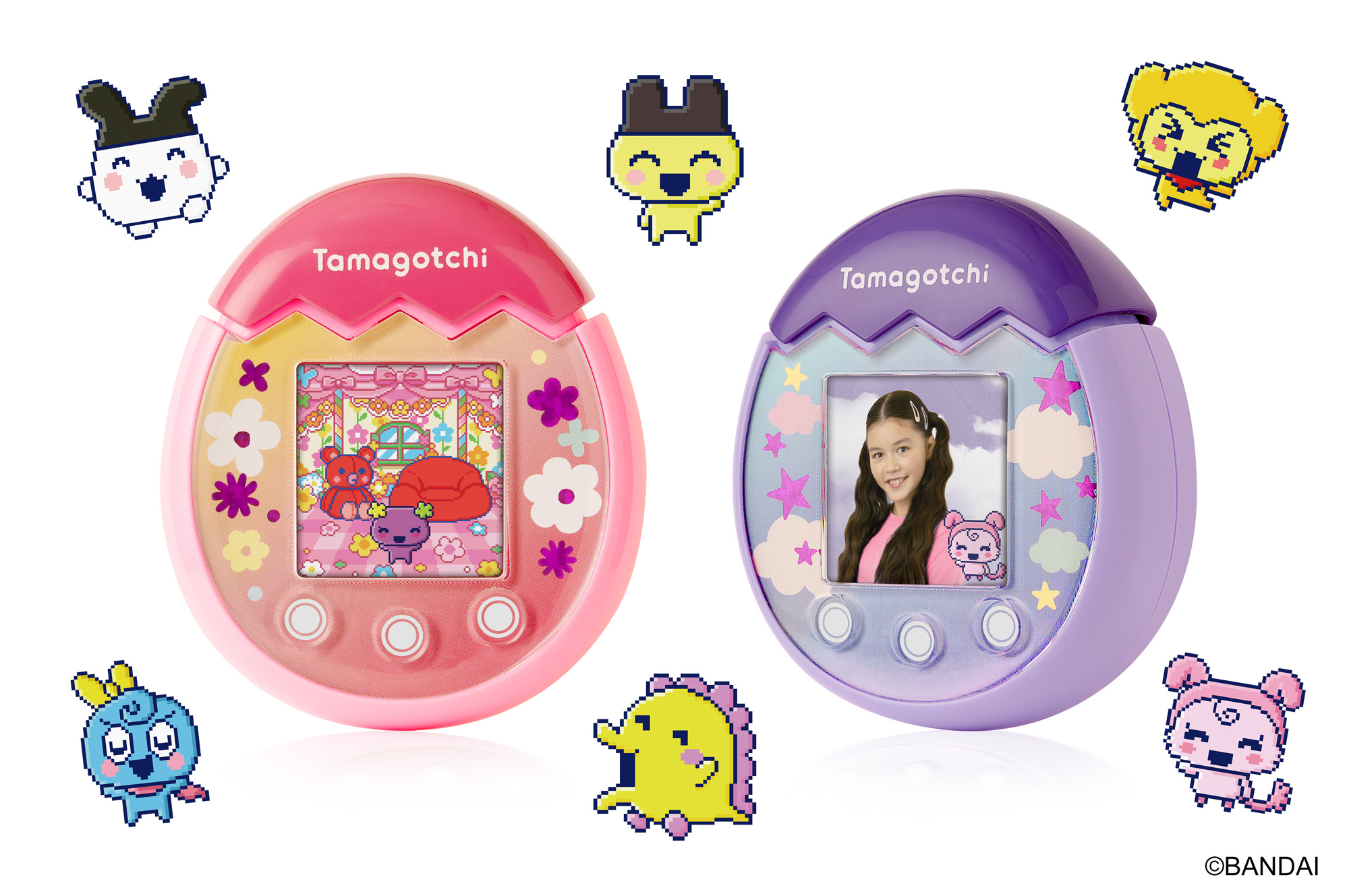 A pink Tamagotchi and a purple Tamagotchi, which are egg-shaped devices where little creatures live