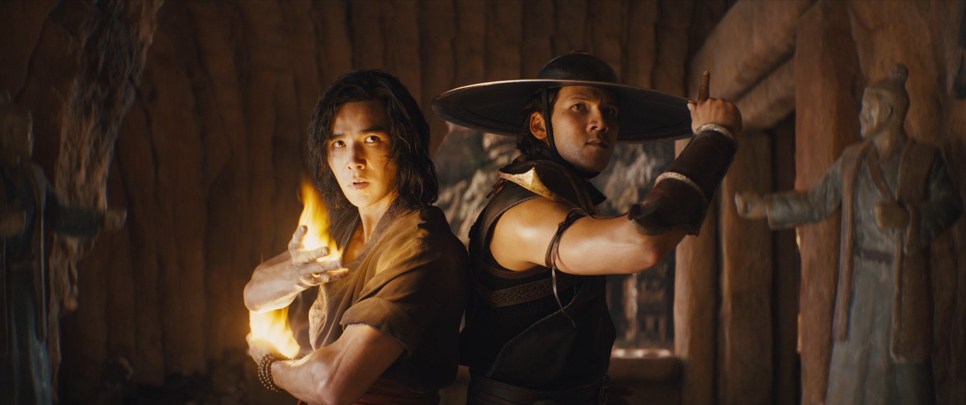 Liu Kang and Kung Lao in Mortal Kombat 2021 stand in a battle pose