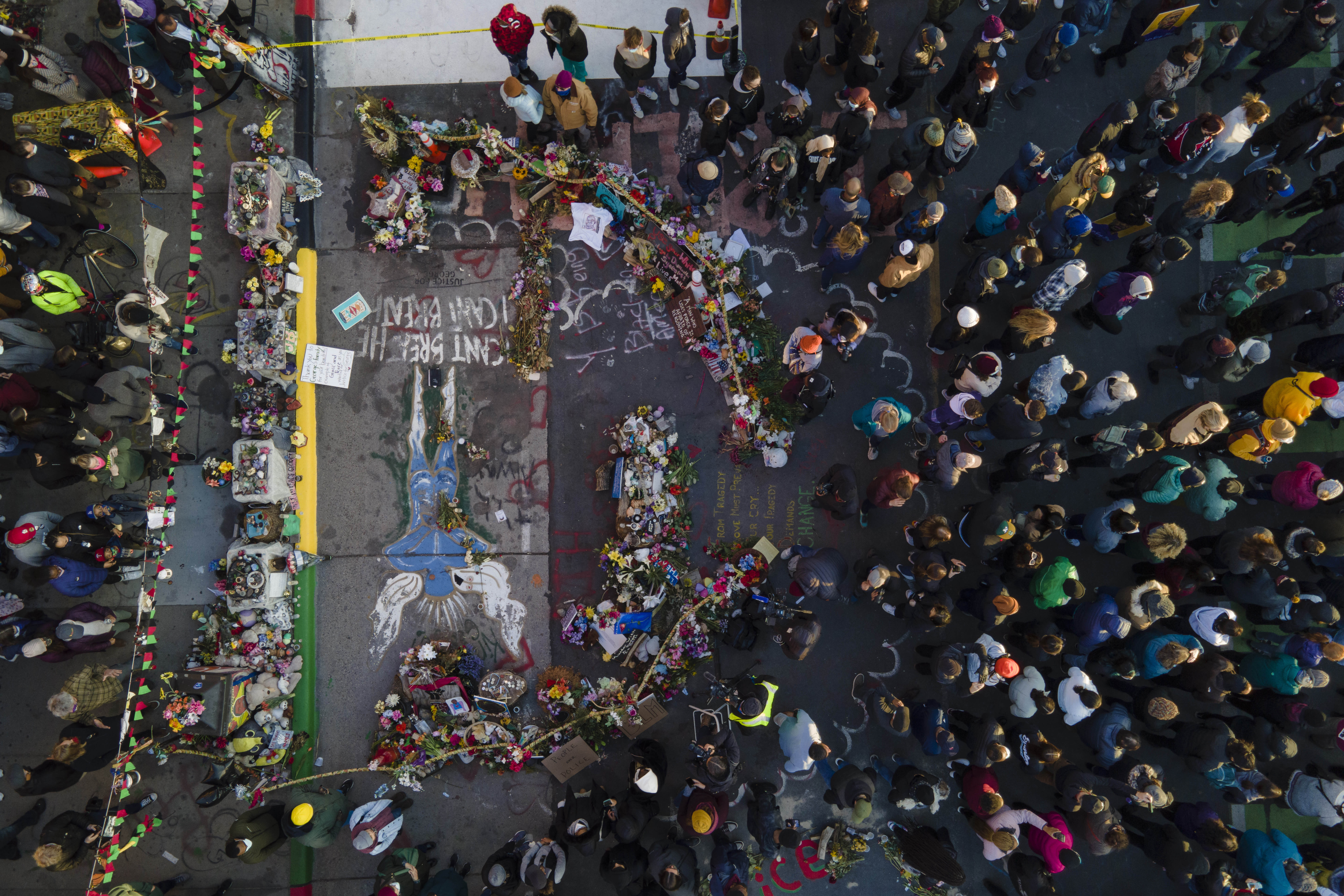 A crowd gathers next to the spot where George Floyd was murdered at George Floyd Square after a guilty verdict was announced at the trial of former Minneapolis police Officer Derek Chauvin for the 2020 death of Floyd, Tuesday, April 20, 2021, in Minneapolis.