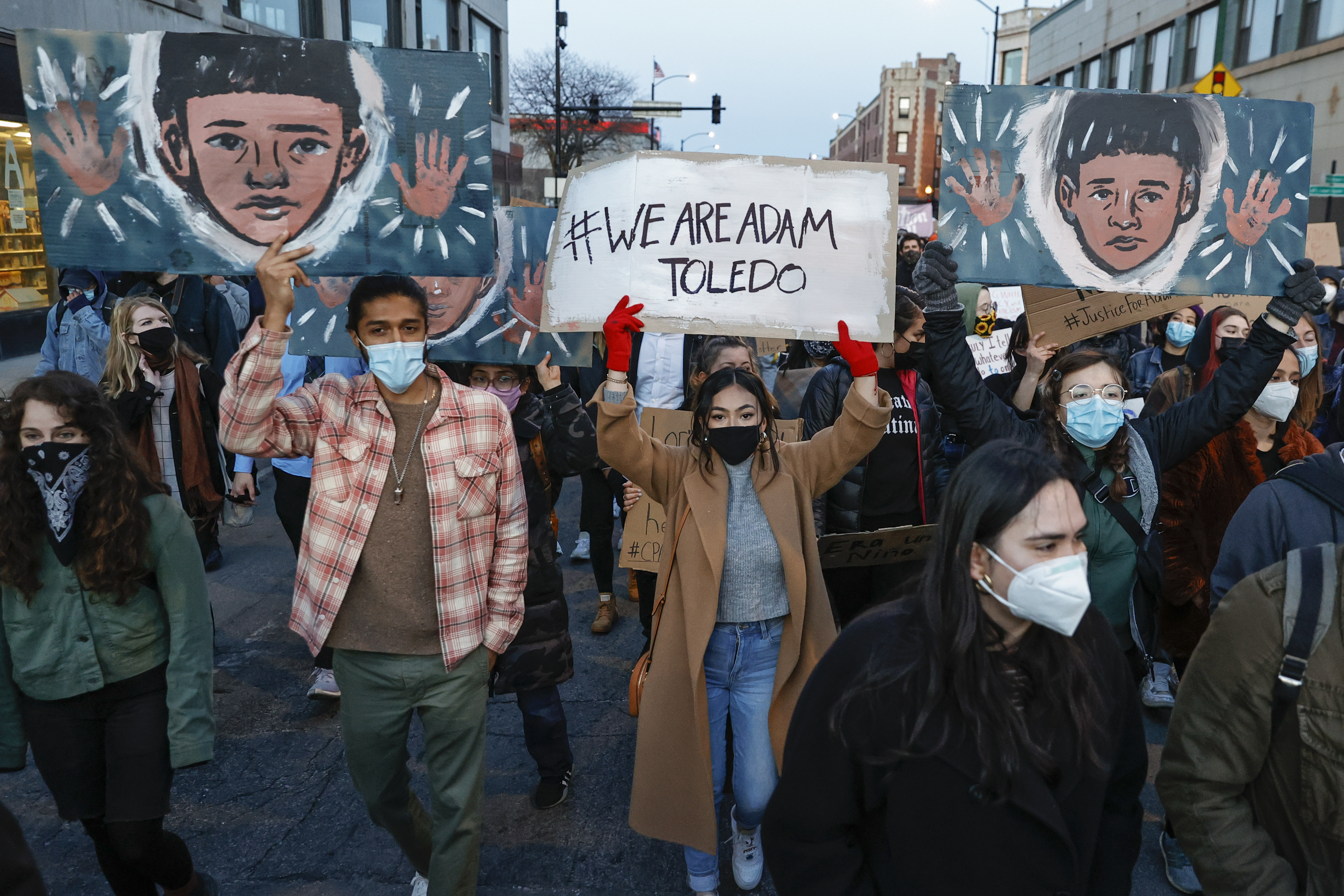 CHICAGO, IL - APRIL 16: Protesters march through Logan Square neighborhood during a rally on April 16, 2021 in Chicago, Illinois. The rally was held to protest the killing of 13-year-old Adam Toledo by a Chicago Police officer on March 29th. The video of the fatal shooting was released on Thursday to the general public by the Civilian Office of Police Accountability more than two weeks after the incident took place. (Photo by Kamil Krzaczynski/Getty Images)