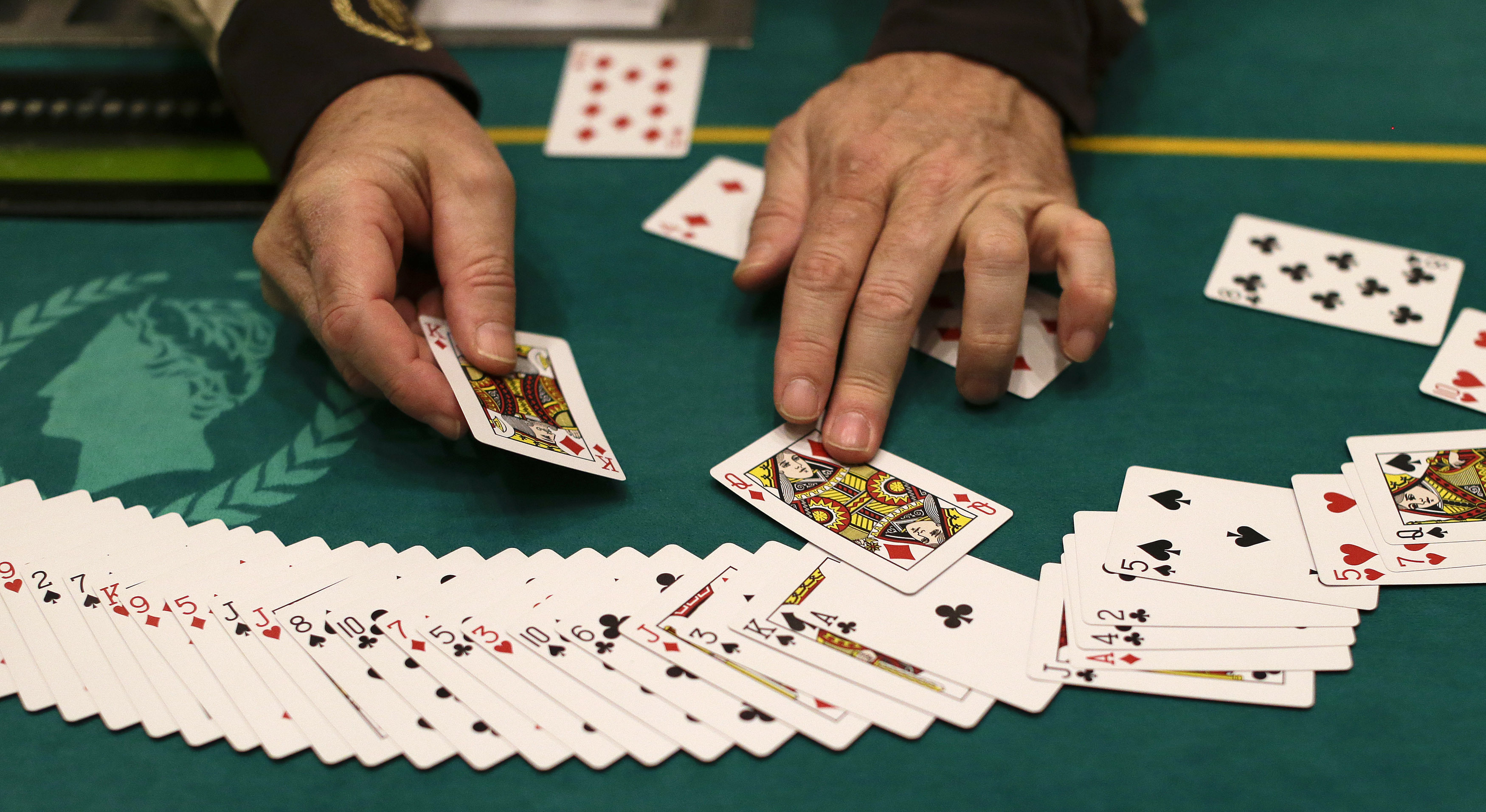 A dealer resets a deck of cards during a break in poker play at Caesar's Palace in Las Vegas in 2013.