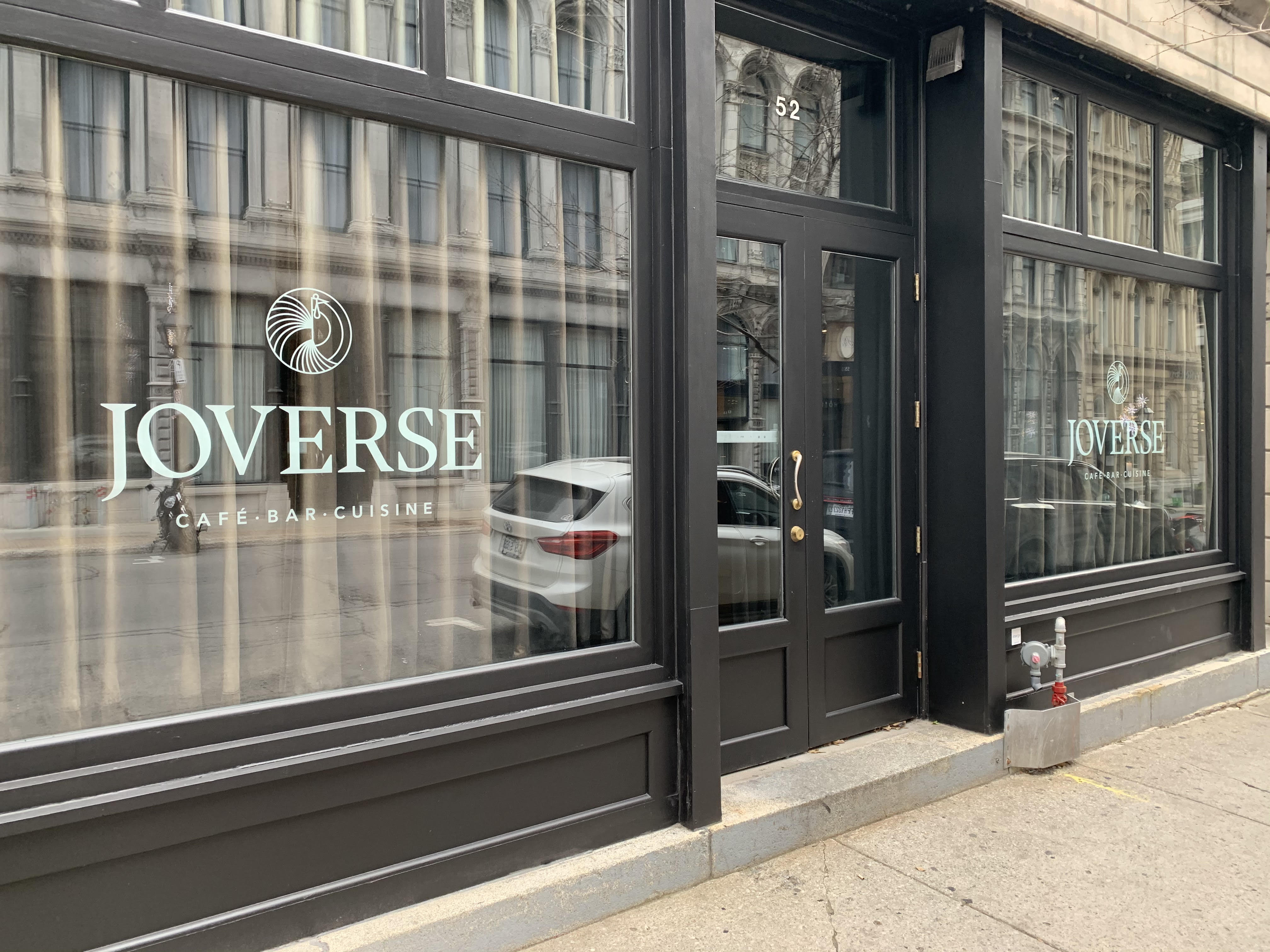 """front of restaurant with word """"Joverse"""" on window"""