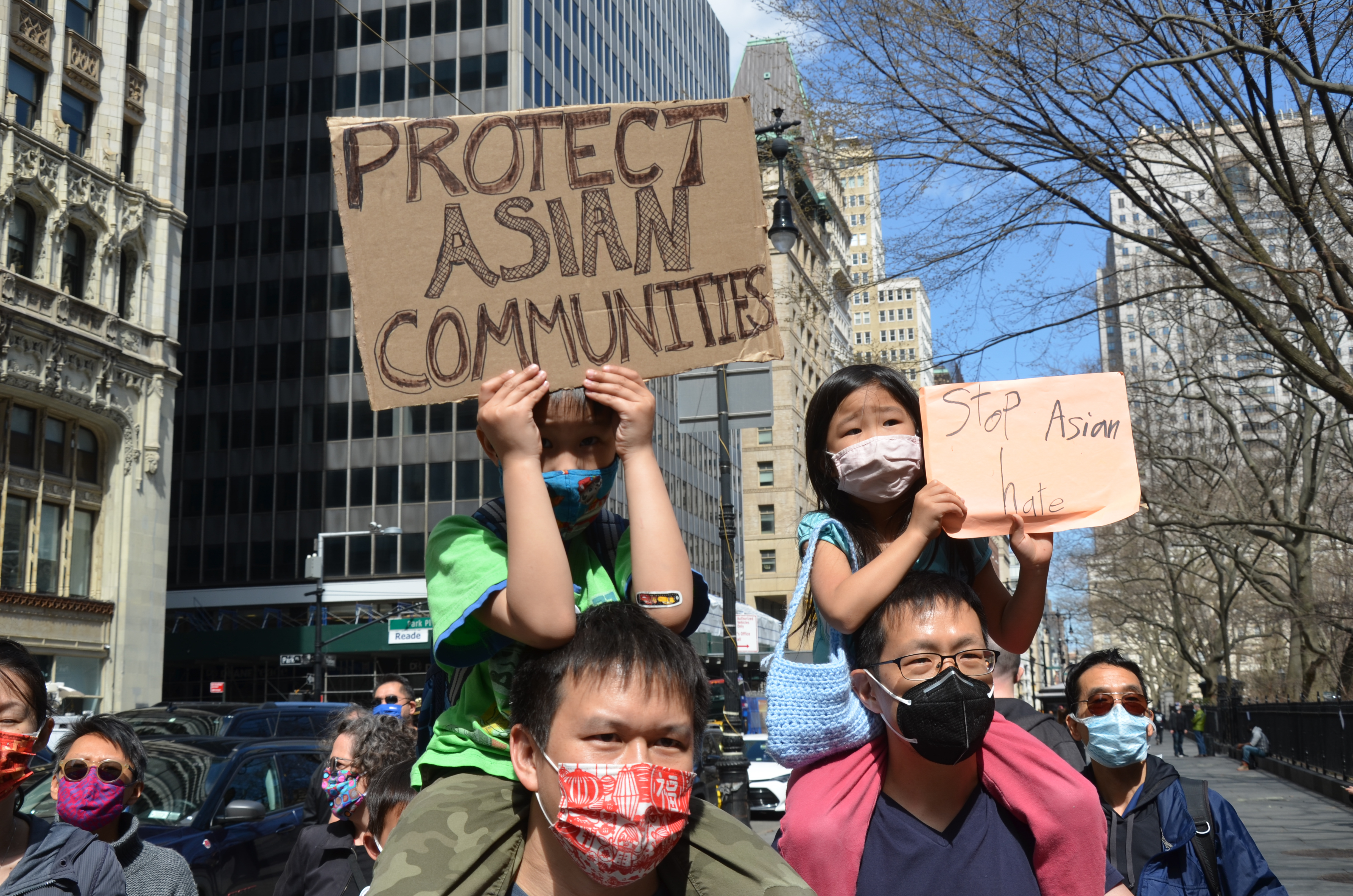 Young participants are seen holding a placard near NYC City...