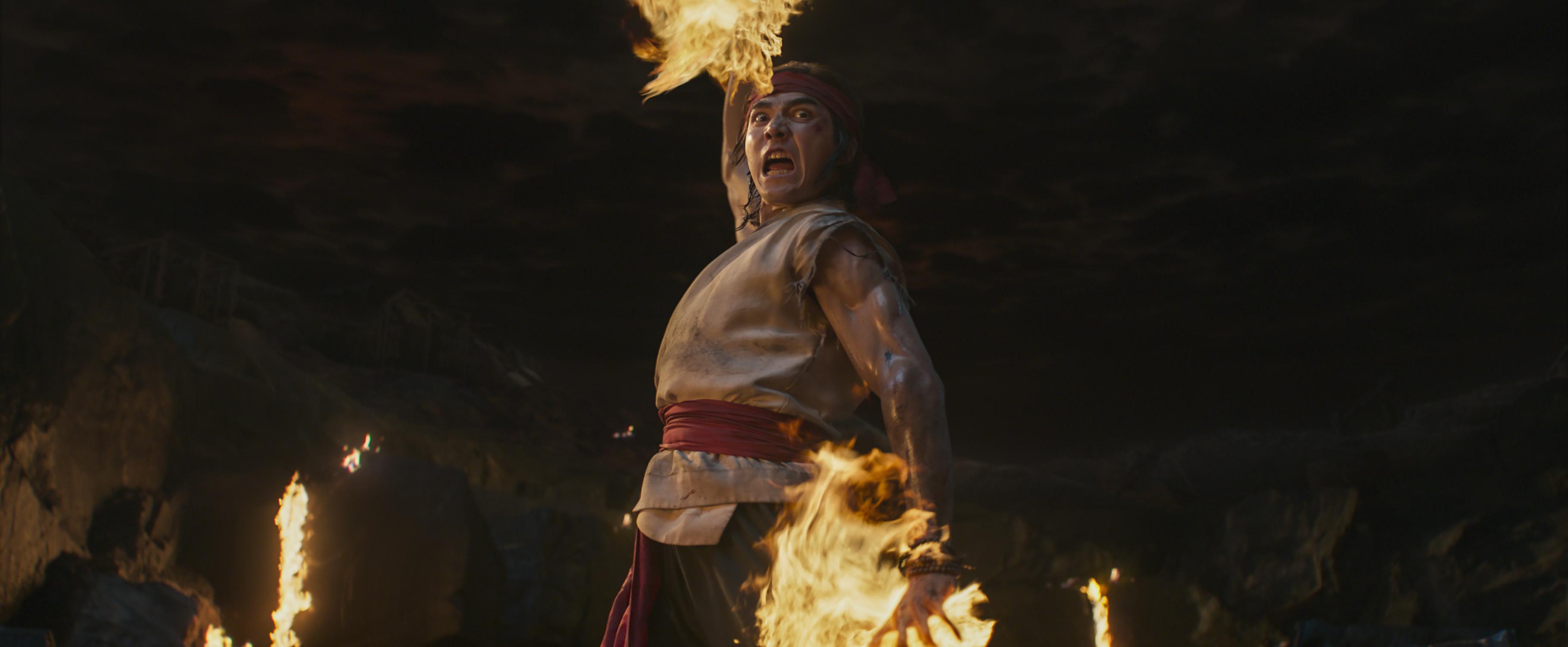 Ludi Lin screams as he prepares a burning-hands attack in his role as Liu Kang in 2021's Mortal Kombat