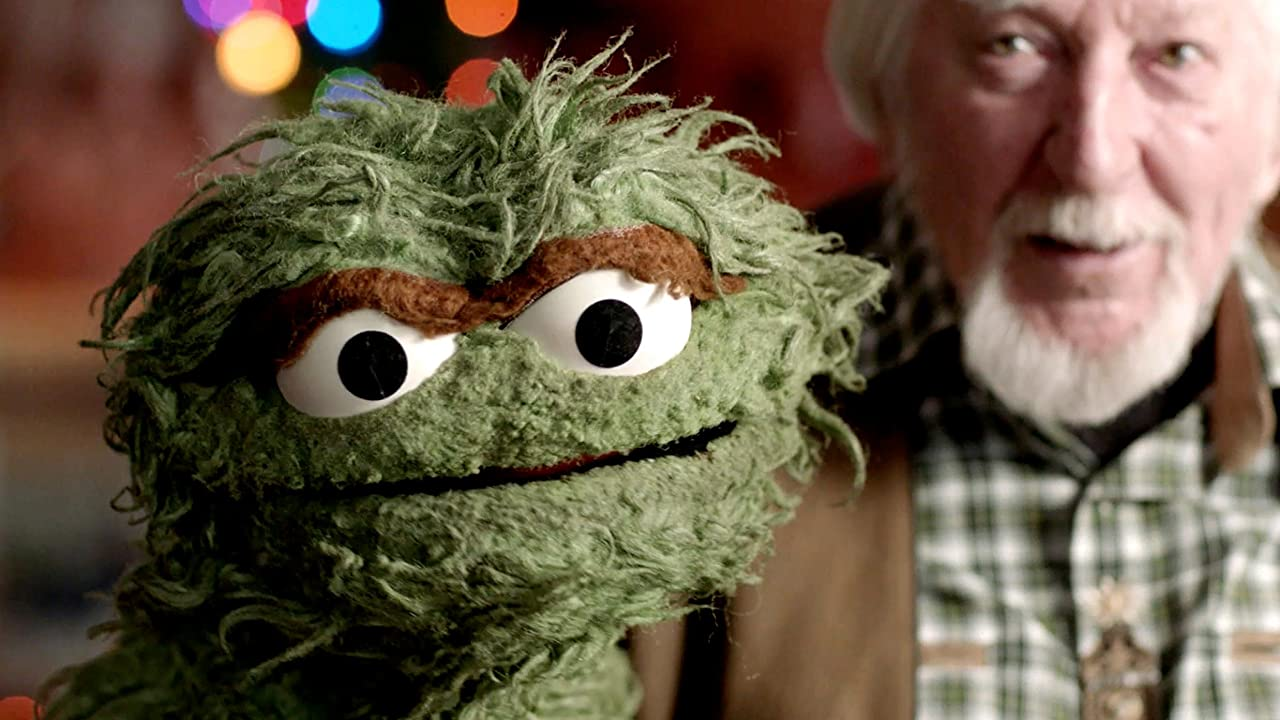 Puppet-maker Kermit Love holds up an Oscar the Grouch puppet in a scene from Street Gang