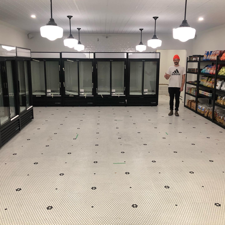 man standing in empty beer store