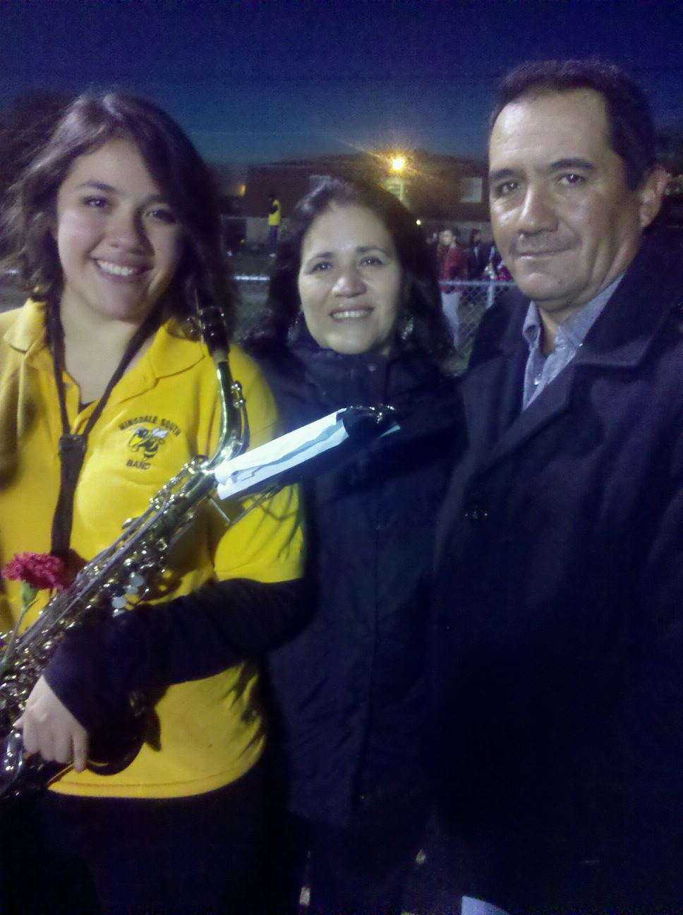 (Left to right) Jessica with her parents Maria and Luis Villagomez at a senior year send-off.