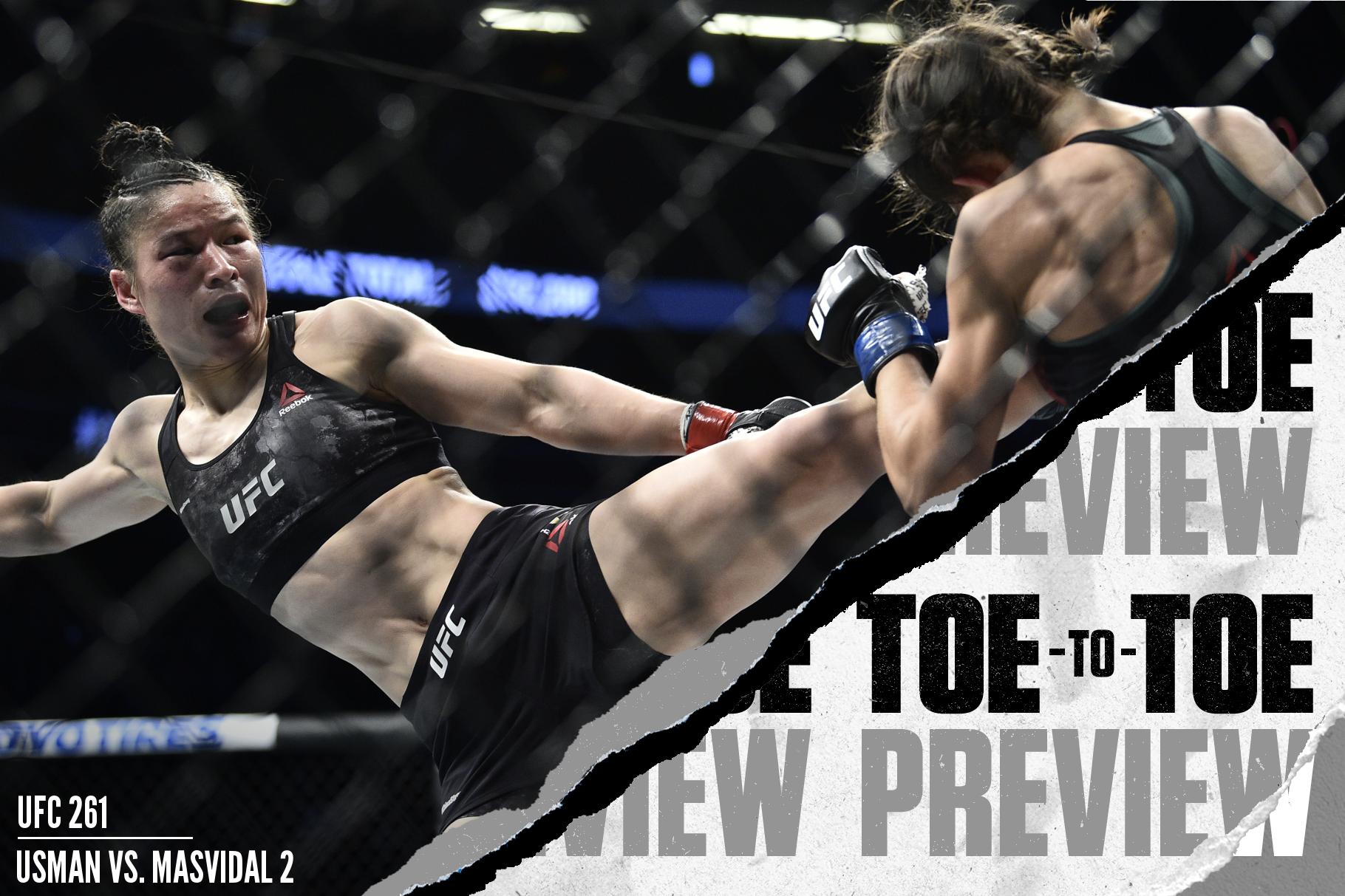 Strawweight champion Zhang Weili (left) kicks Joanna Jedrzejczyk (right) at UFC 248.