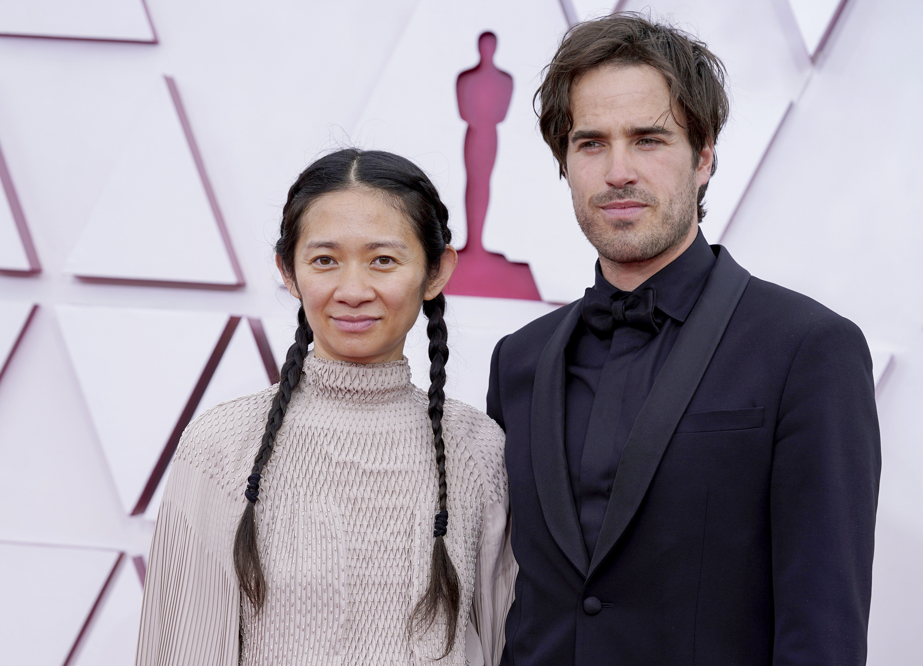 Chloe Zhao and Joshua James Richards attend the 93rd Annual Academy Awards at Union Station on April 25, 2021 in Los Angeles, California.