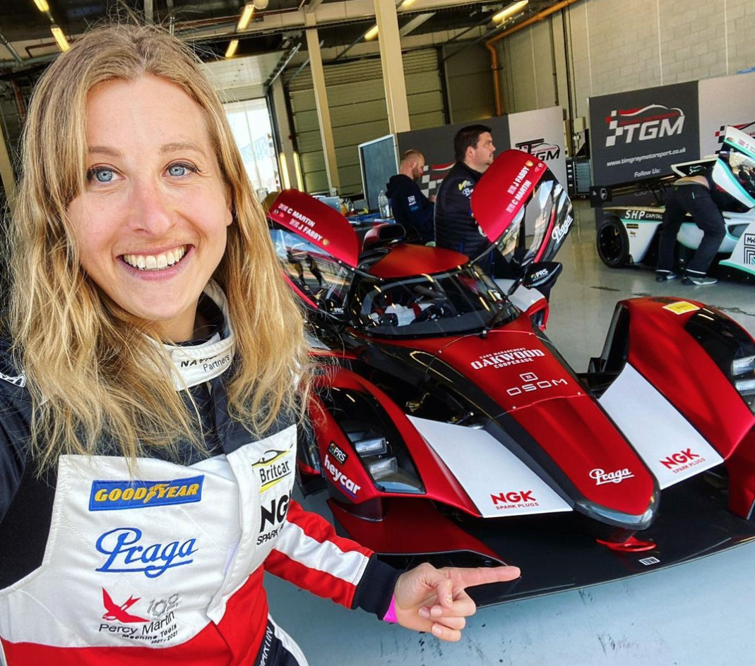 Charlie Martin shows off her racecar before the race.