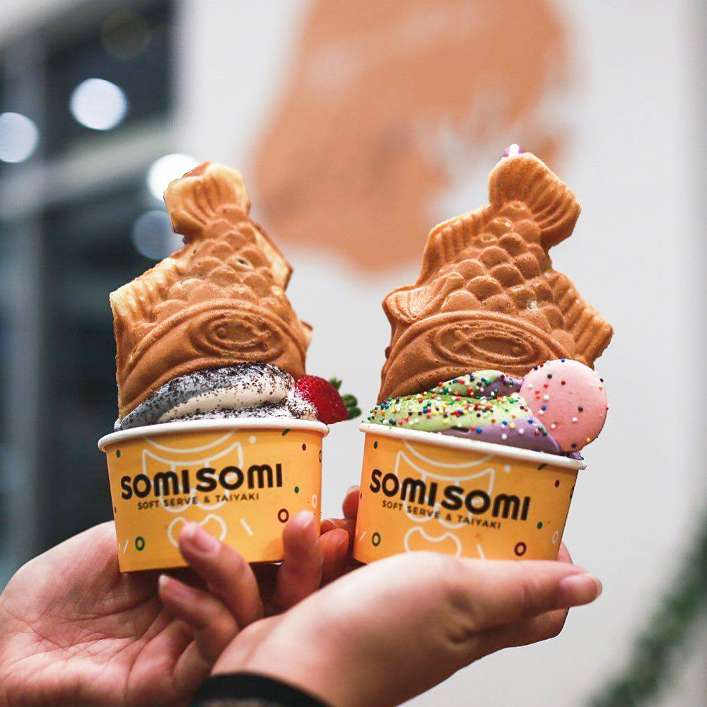 Two cups of ah-boong, goldfish-shaped cones filled with soft serve ice cream, on the menu at SomiSomi.