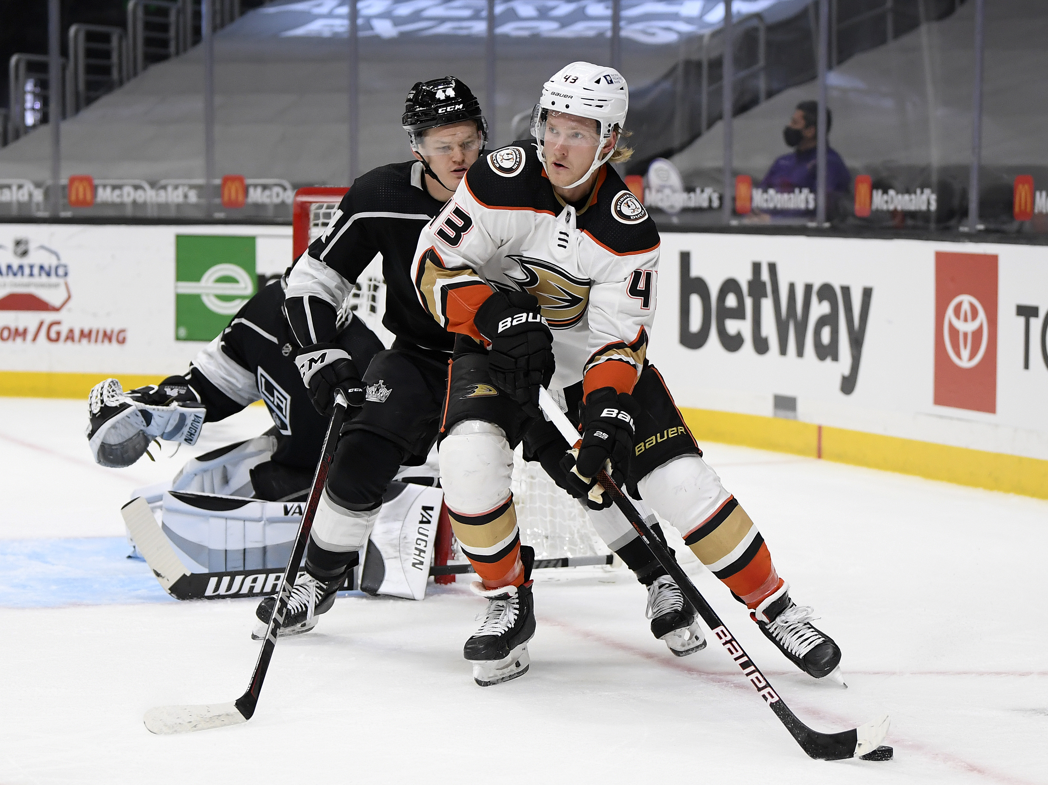 Danton Heinen #43 of the Anaheim Ducks fends off Mikey Anderson #44 of the Los Angeles Kings during the first period at Staples Center on April 20, 2021 in Los Angeles, California.