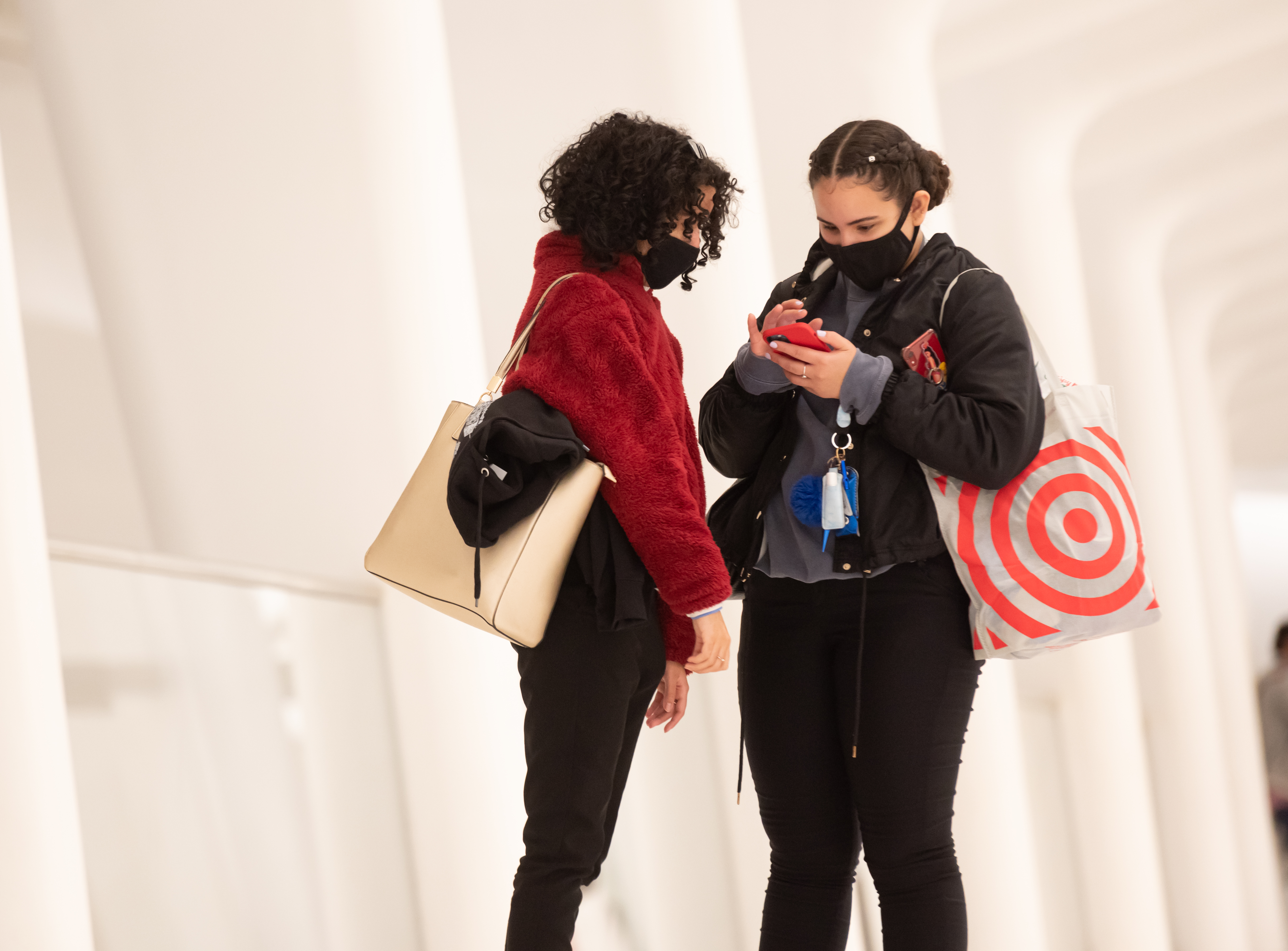 Two people wear masks at the Oculus in New York City.