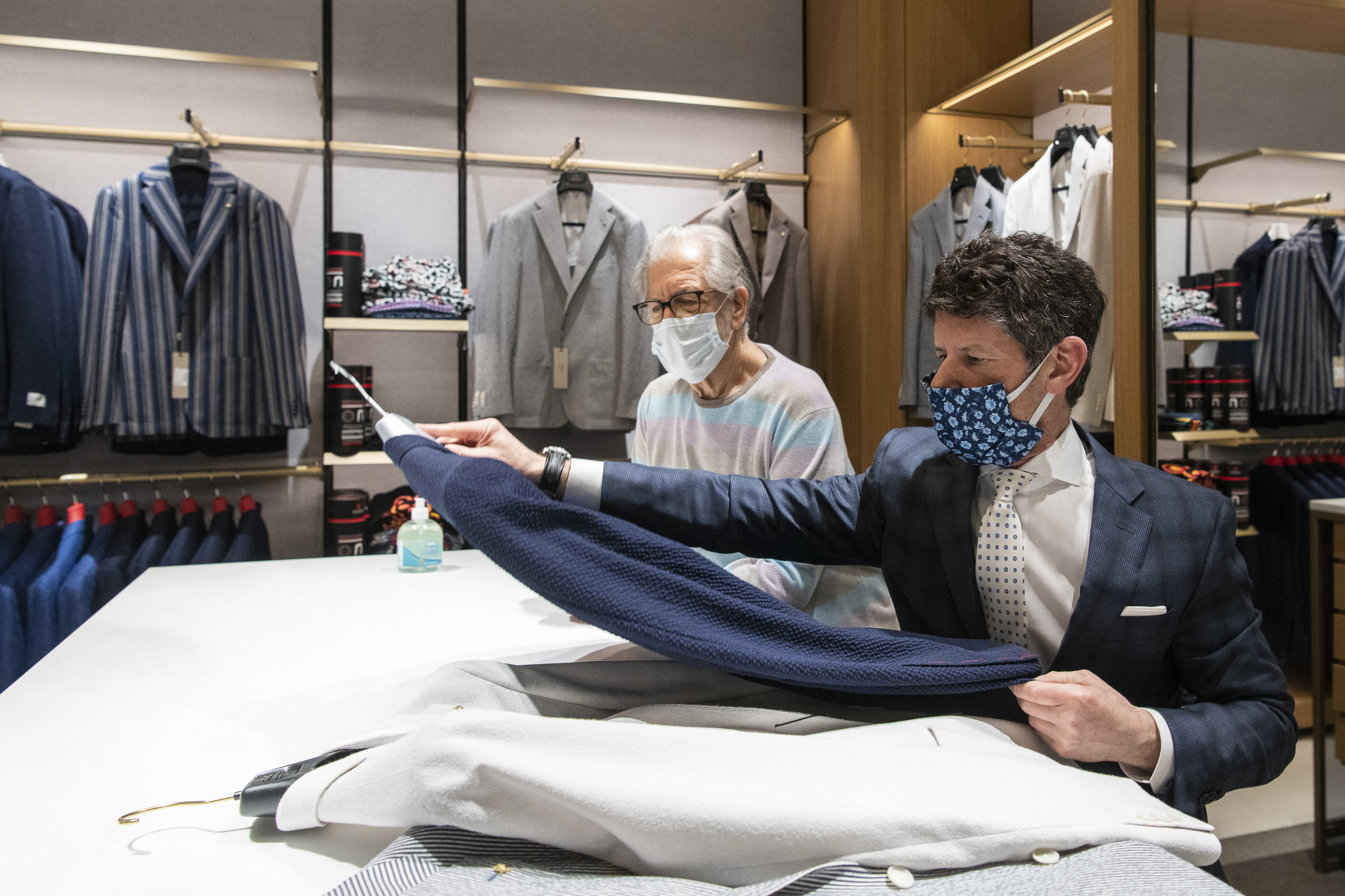 Scott Shapiro owner of Syd Jerome, picks out sports coats for Marc Kadish in May 2020.