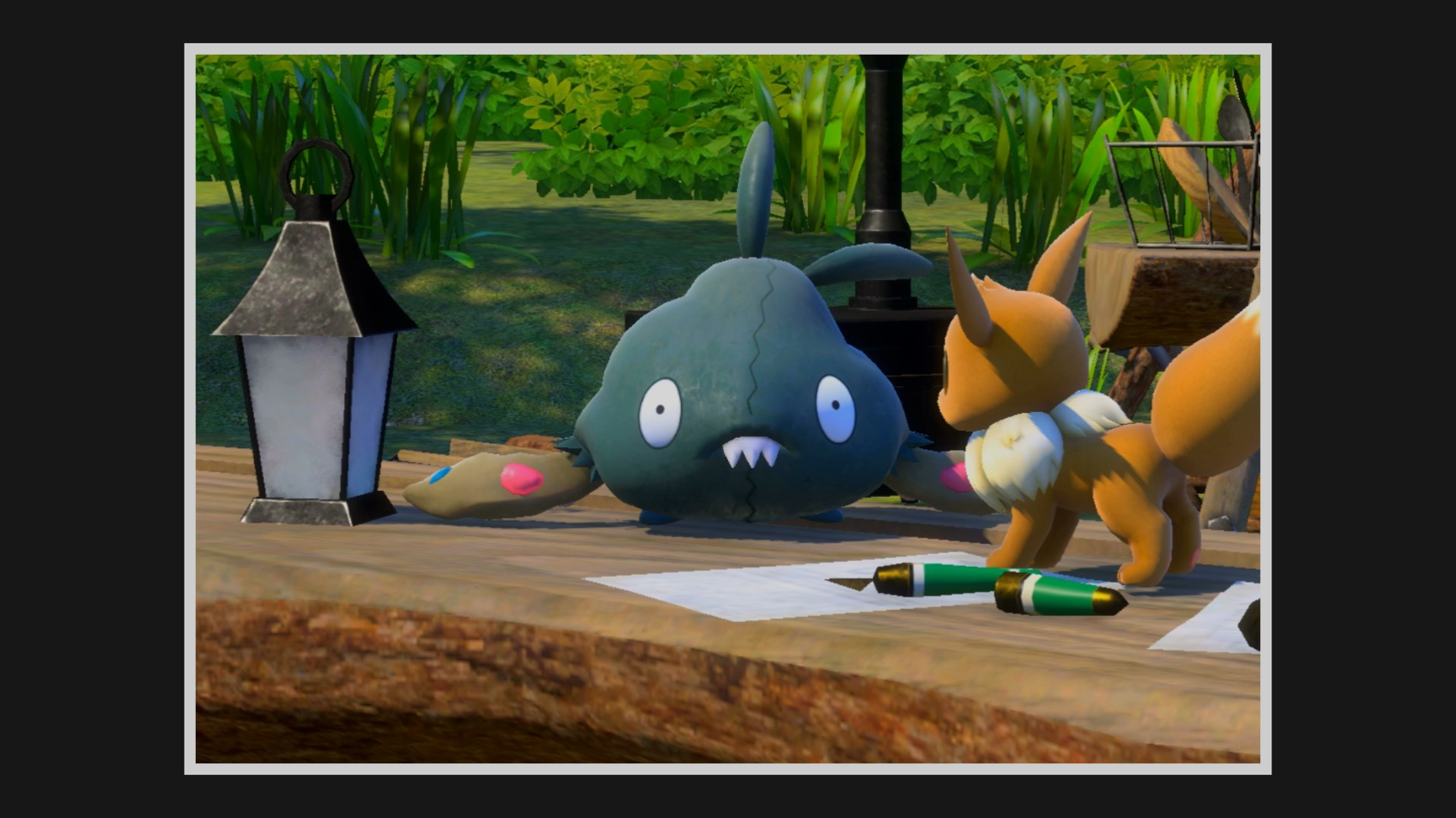 A Trubbish stares at the camera while standing next to an Eevee on a table