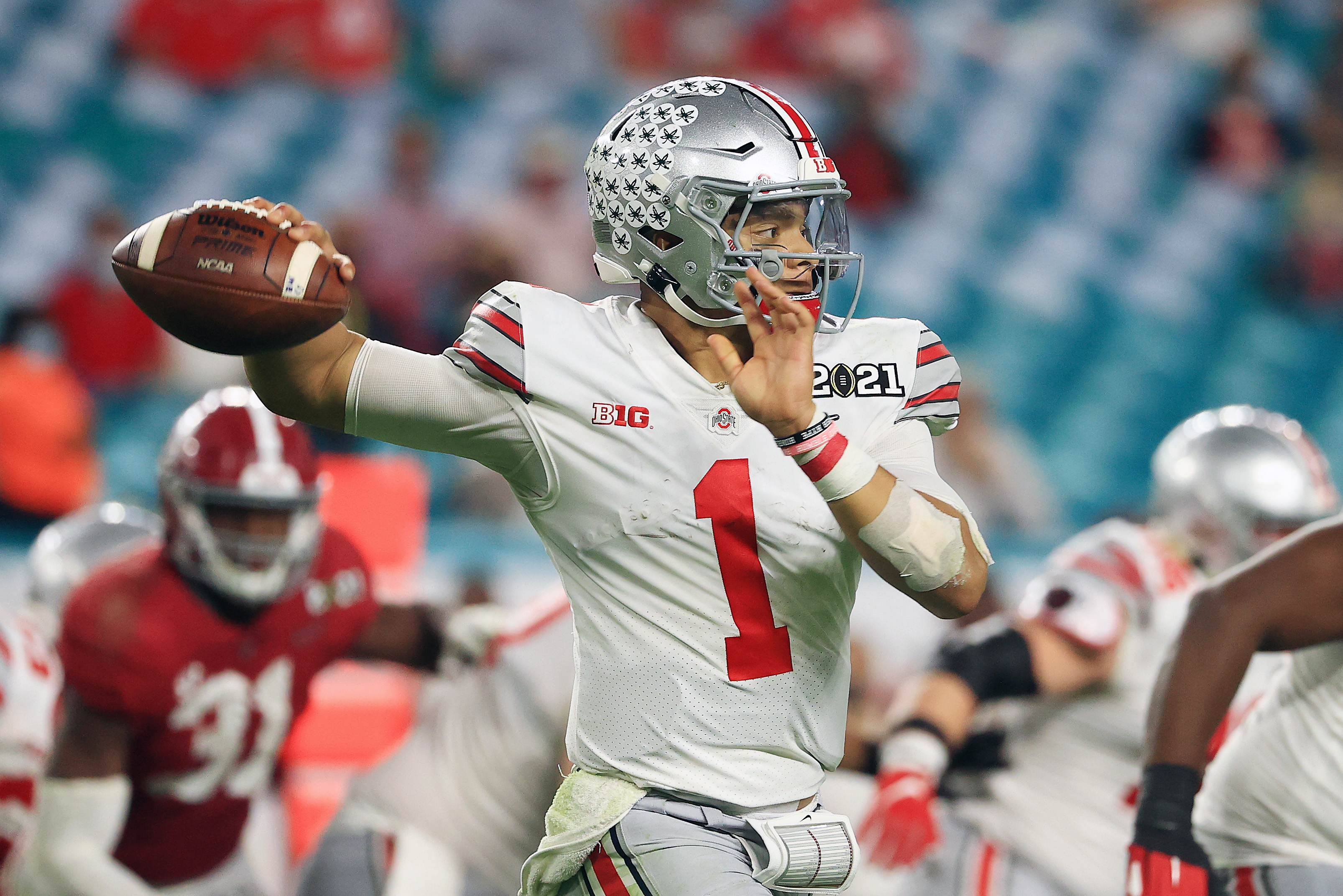 Justin Fields #1 of the Ohio State Buckeyes looks to pass during the fourth quarter of the College Football Playoff National Championship game against the Alabama Crimson Tide at Hard Rock Stadium on January 11, 2021 in Miami Gardens, Florida.