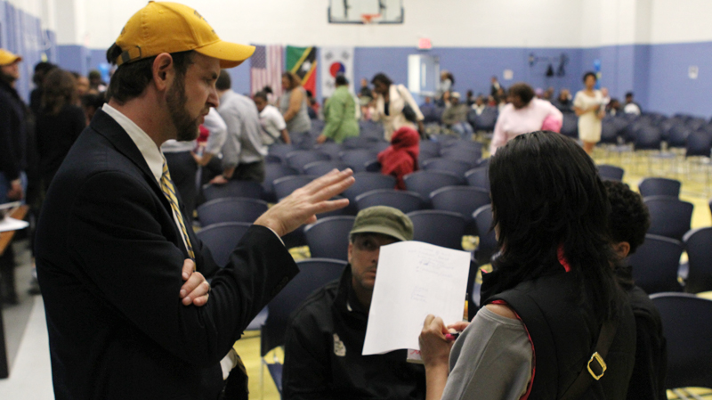 Superintendent Seth Andrew answers questions after the lottery event at Democracy Prep