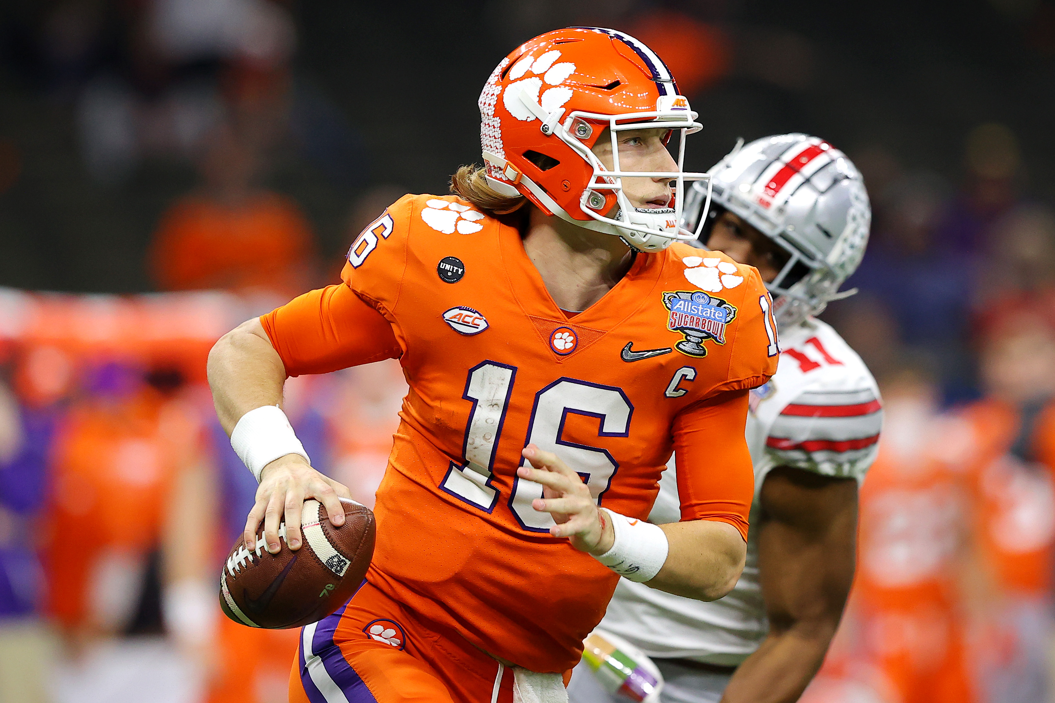 Trevor Lawrence #16 of the Clemson Tigers looks to pass in the third quarter against the Ohio State Buckeyes during the College Football Playoff semifinal game at the Allstate Sugar Bowl at Mercedes-Benz Superdome on January 01, 2021 in New Orleans, Louisiana.
