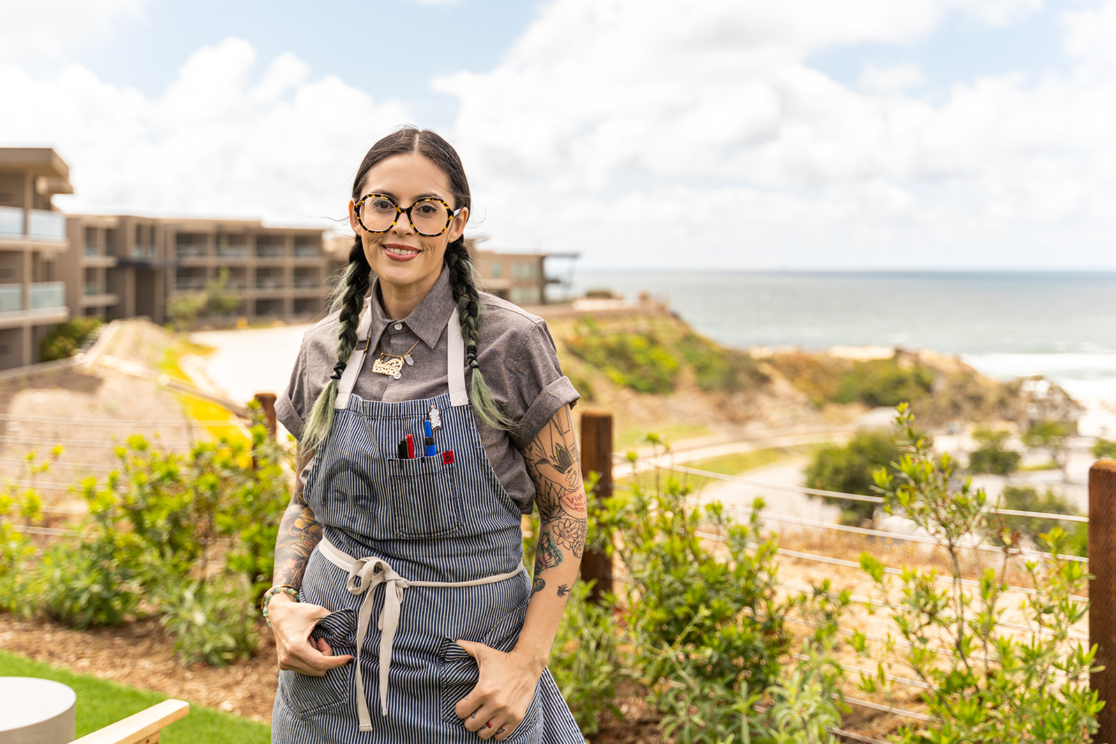 Chef Claudette Zepeda stands in front of Vaga restaurant at the Alila Marea Beach Resort