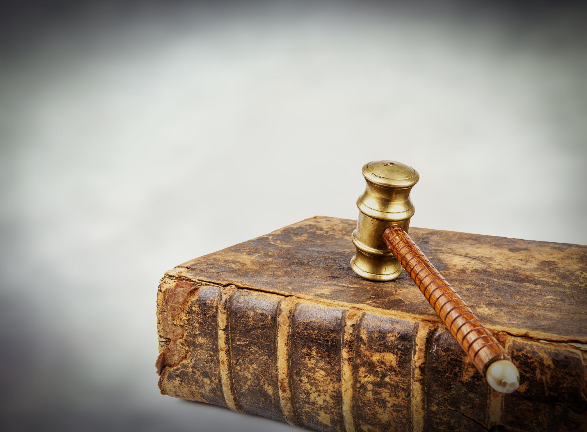 Judges gavel on old law book