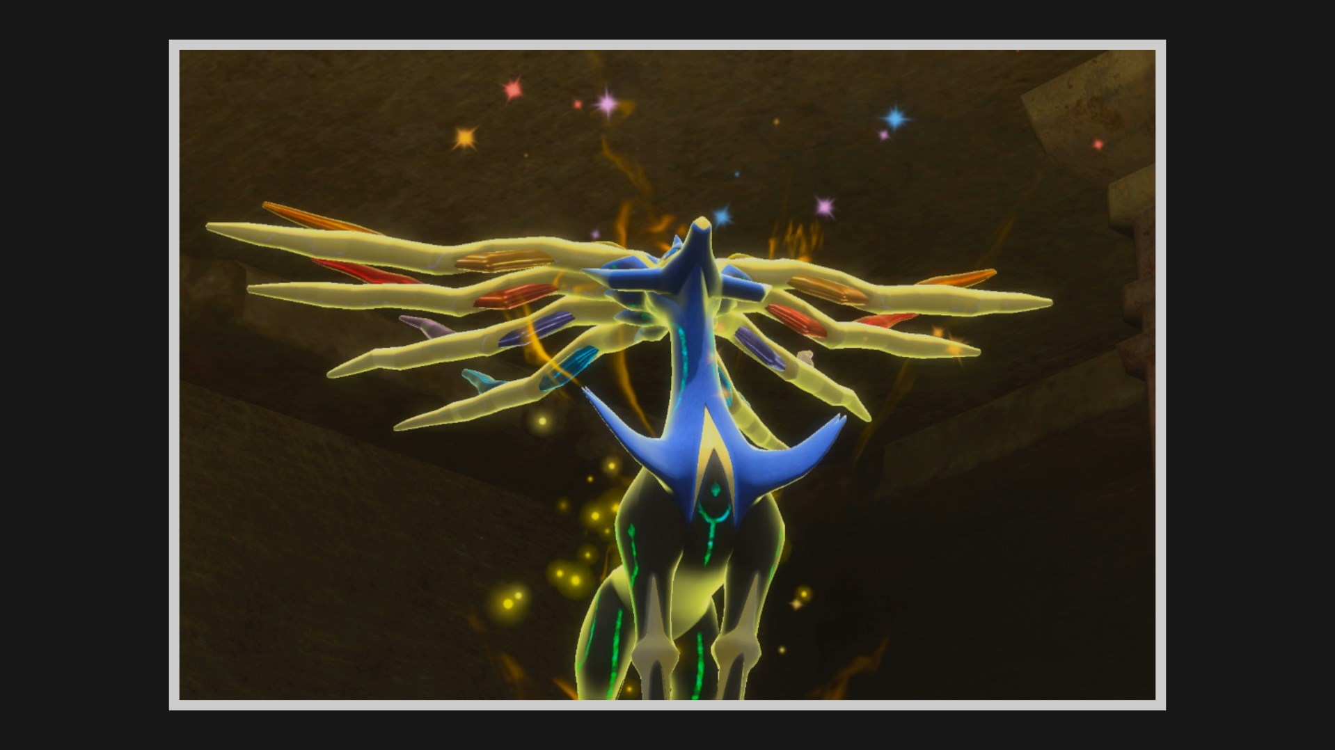 Xerneas looks up at the sky while it has a golden glow