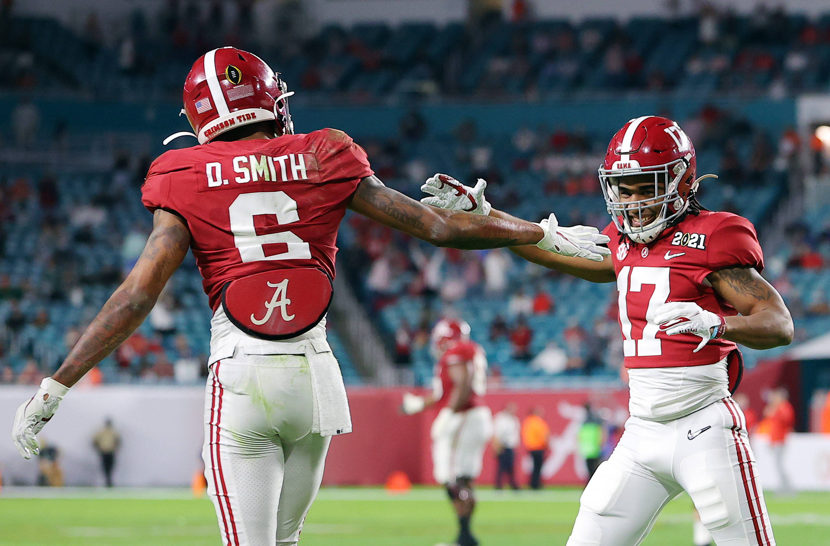 DeVonta Smith #6 of the Alabama Crimson Tide celebrates his touchdown with Jaylen Waddle #17 during the second quarter of the College Football Playoff National Championship game against the Ohio State Buckeyes at Hard Rock Stadium on January 11, 2021 in Miami Gardens, Florida.