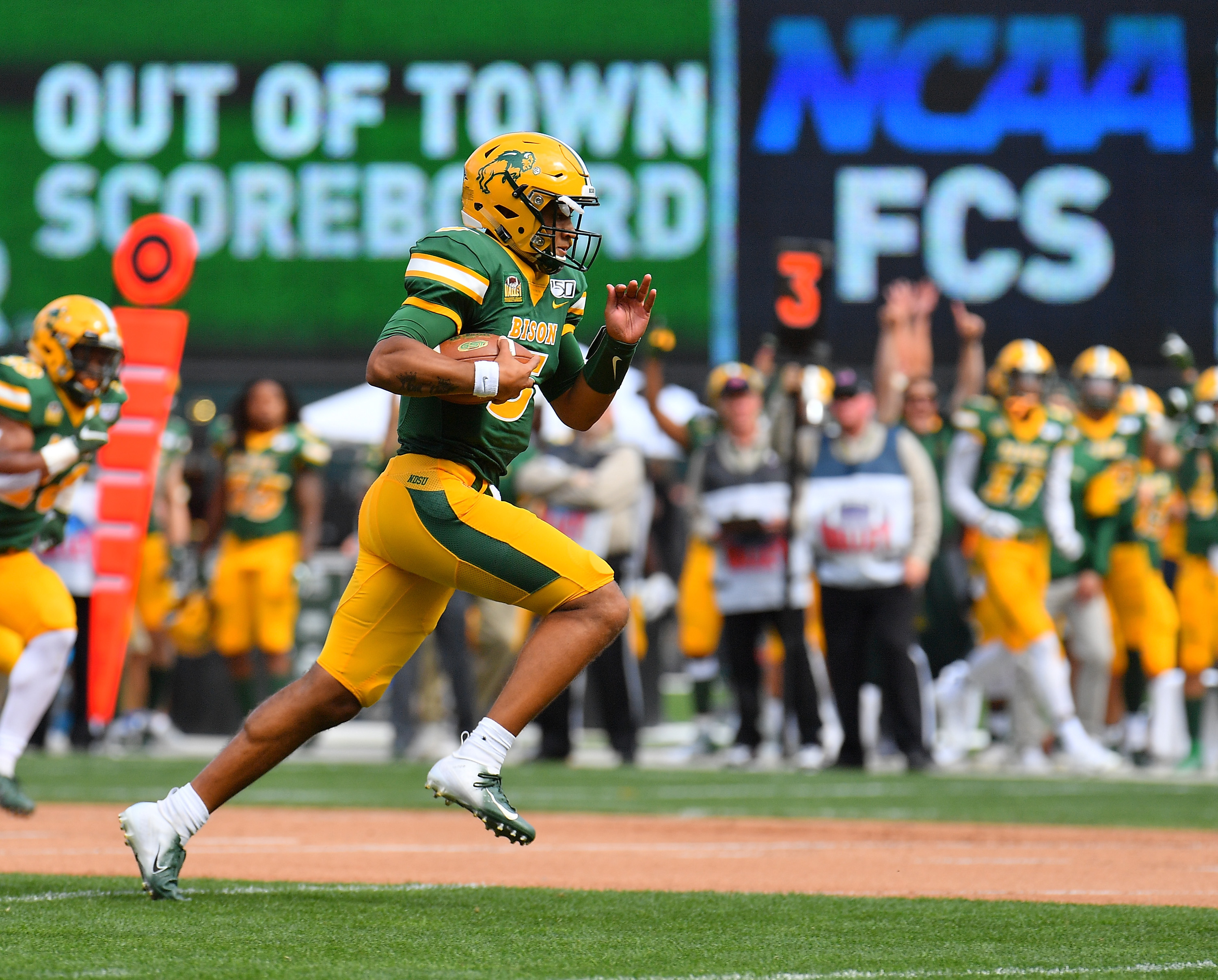 Quarterback Trey Lance #5 of the North Dakota State Bison runs for a touchdown against the Butler Bulldogs during their game at Target Field on August 31, 2019 in Minneapolis, Minnesota.