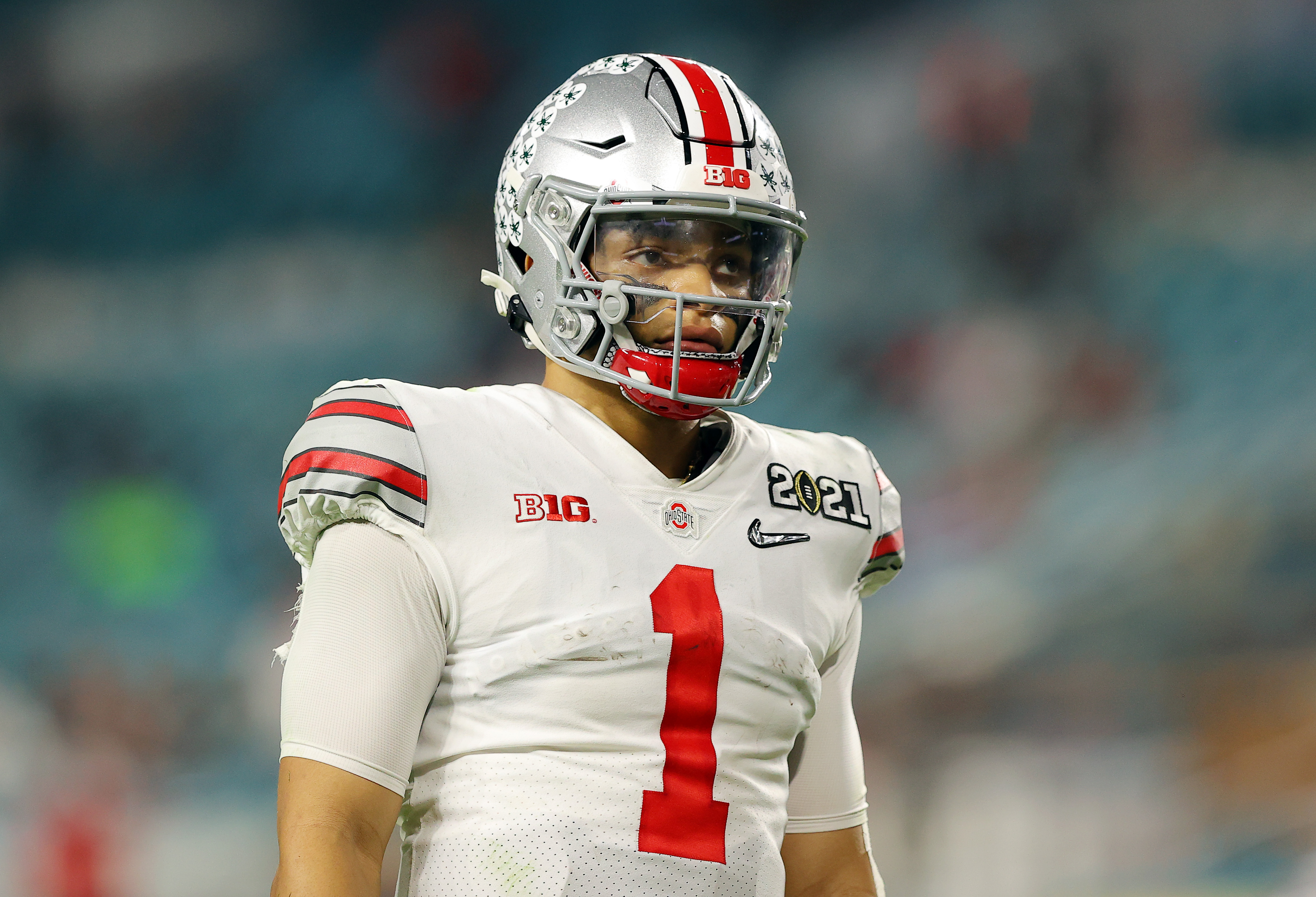 Justin Fields #1 of the Ohio State Buckeyes looks on during the fourth quarter of the College Football Playoff National Championship game against the Alabama Crimson Tide at Hard Rock Stadium on January 11, 2021 in Miami Gardens, Florida.