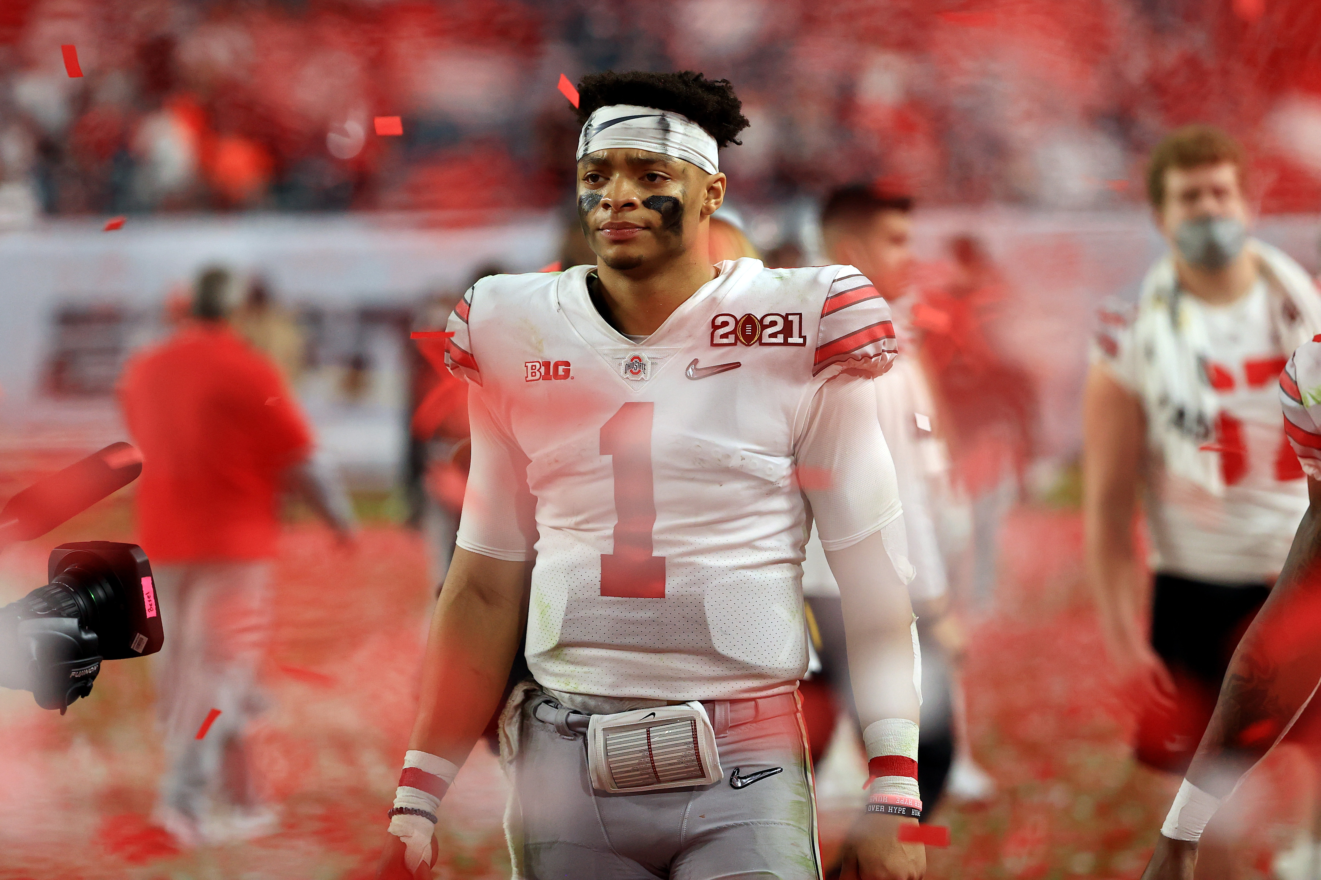 Justin Fields #1 of the Ohio State Buckeyes leaves the field following the College Football Playoff National Championship game against the Alabama Crimson Tide at Hard Rock Stadium on January 11, 2021 in Miami Gardens, Florida.