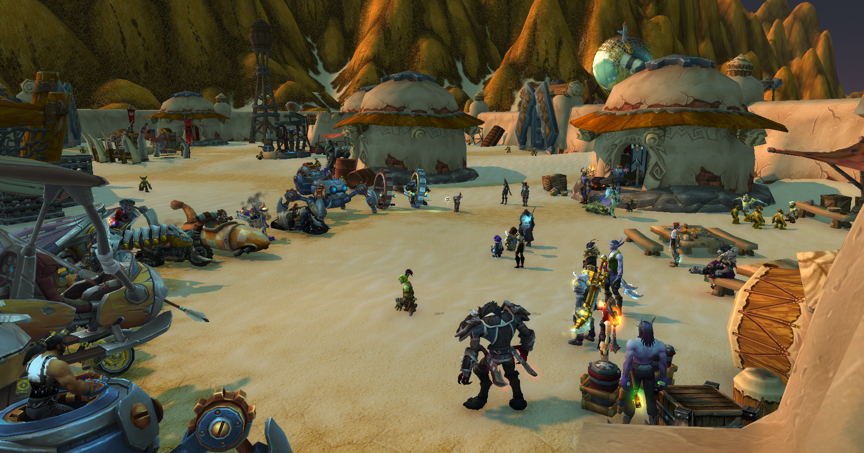 World of Warcraft - a group of players, riding a variety of cool mounts, gather in the goblin city of Gadgetzan in Tanaris