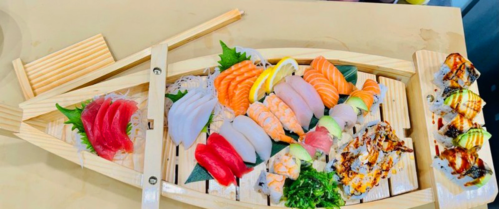 The Sakura boat, featuring special rolls and chef's choices of sashimi and nigiri at Sakura Ya.