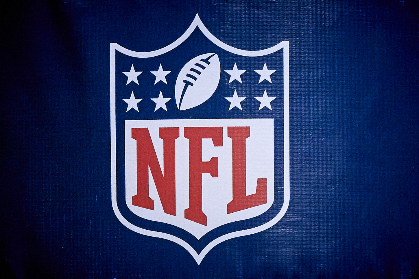 A detailed view of the NFL crest logo is seen on a goal post pad in action during a game between the Chicago Bears and the Green Bay Packers on January 03, 2021 at Soldier Field in Chicago, IL.
