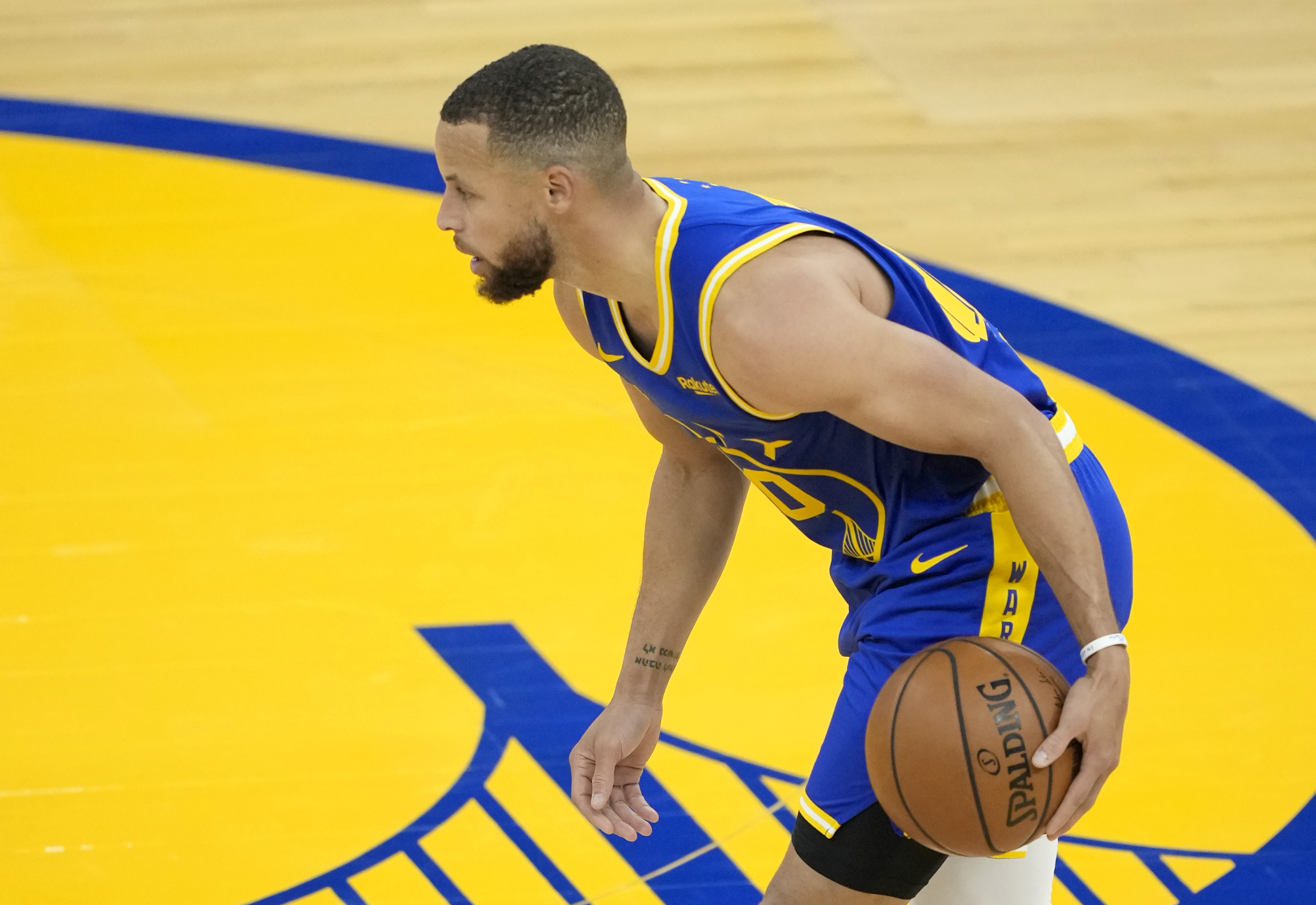 Stephen Curry of the Golden State Warriors dribbles the ball against the Dallas Mavericks during the first half of an NBA basketball game at Chase Center on April 27, 2021 in San Francisco, California.