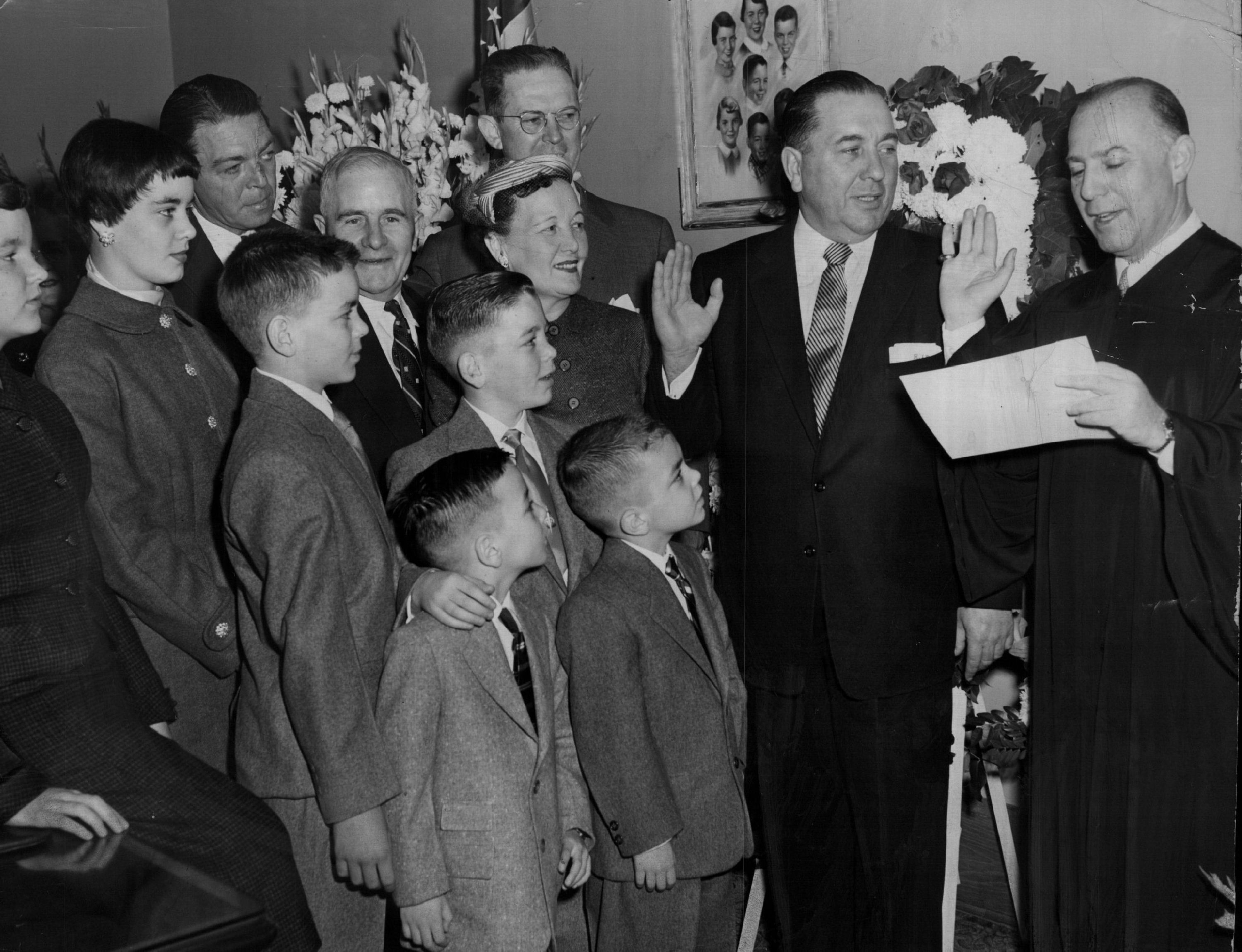 Richard J. Daley, second from right, takes the oath for his second term as Cook County clerk in 1954.