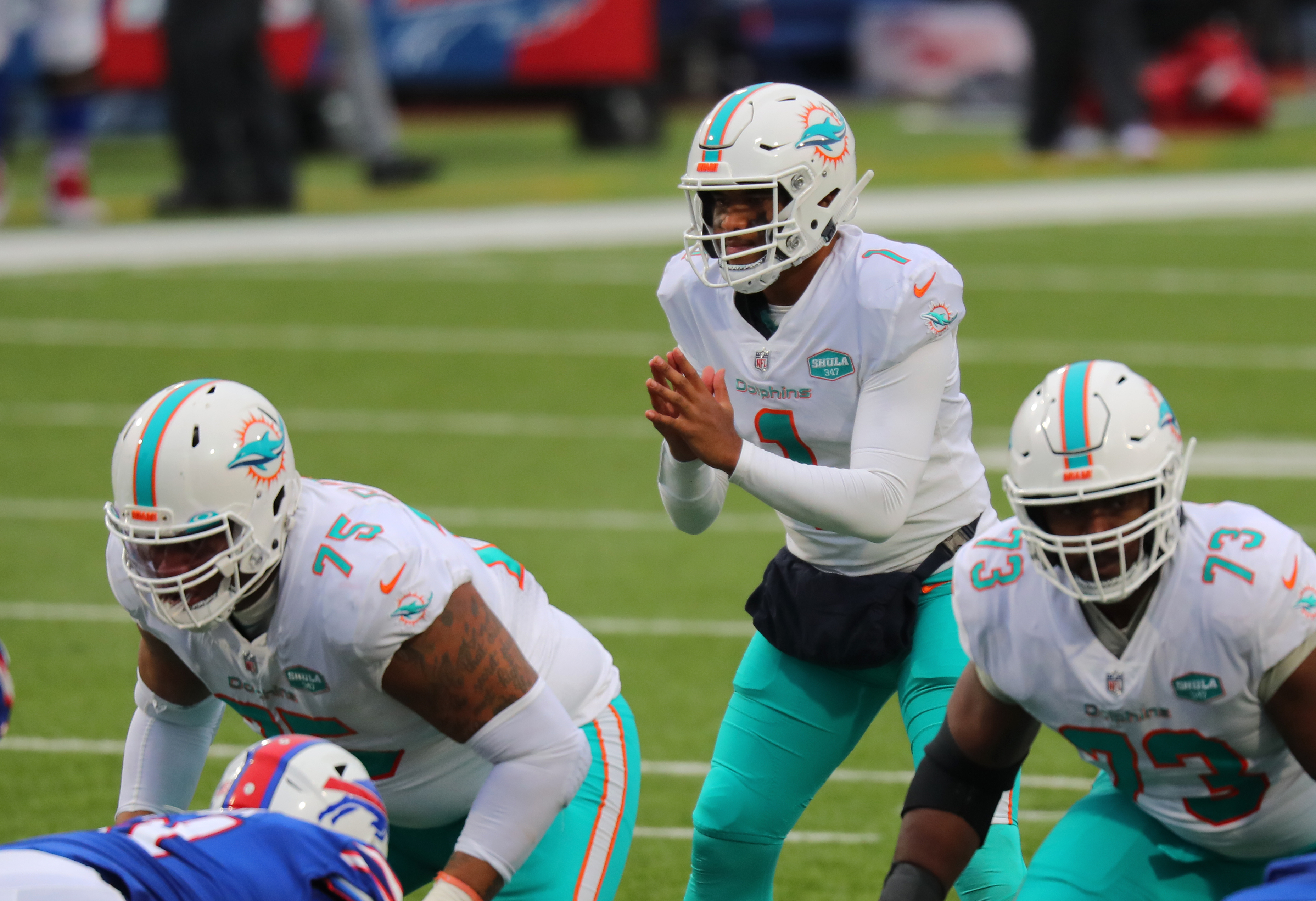 Tua Tagovailoa #1 of the Miami Dolphins waits for the snap during a game against the Buffalo Bills at Bills Stadium on January 3, 2021 in Orchard Park, New York.