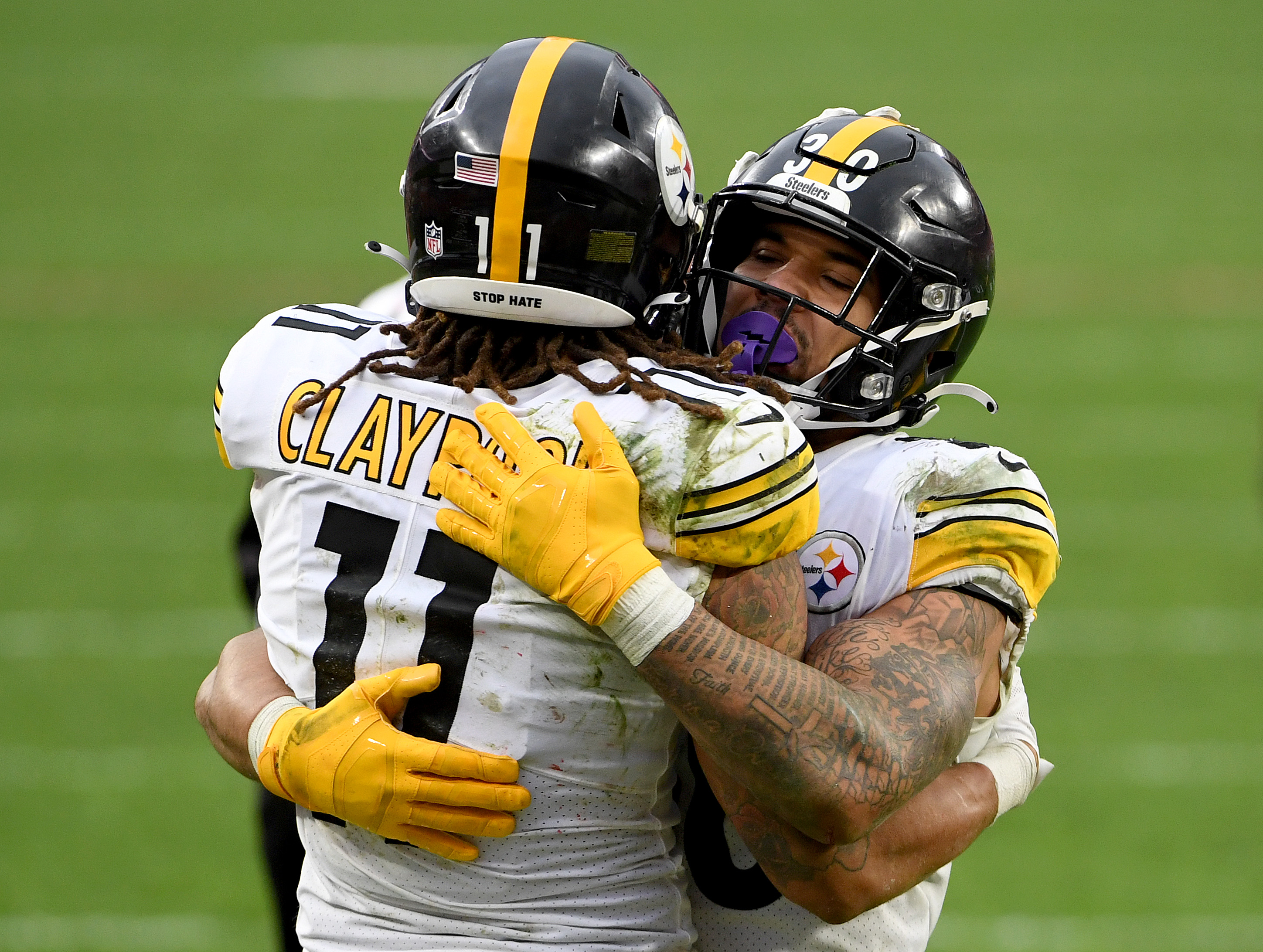 Chase Claypool #11 and James Conner #30 of the Pittsburgh Steelers celebrate a touchdown against the Cleveland Browns in the fourth quarter at FirstEnergy Stadium on January 03, 2021 in Cleveland, Ohio.