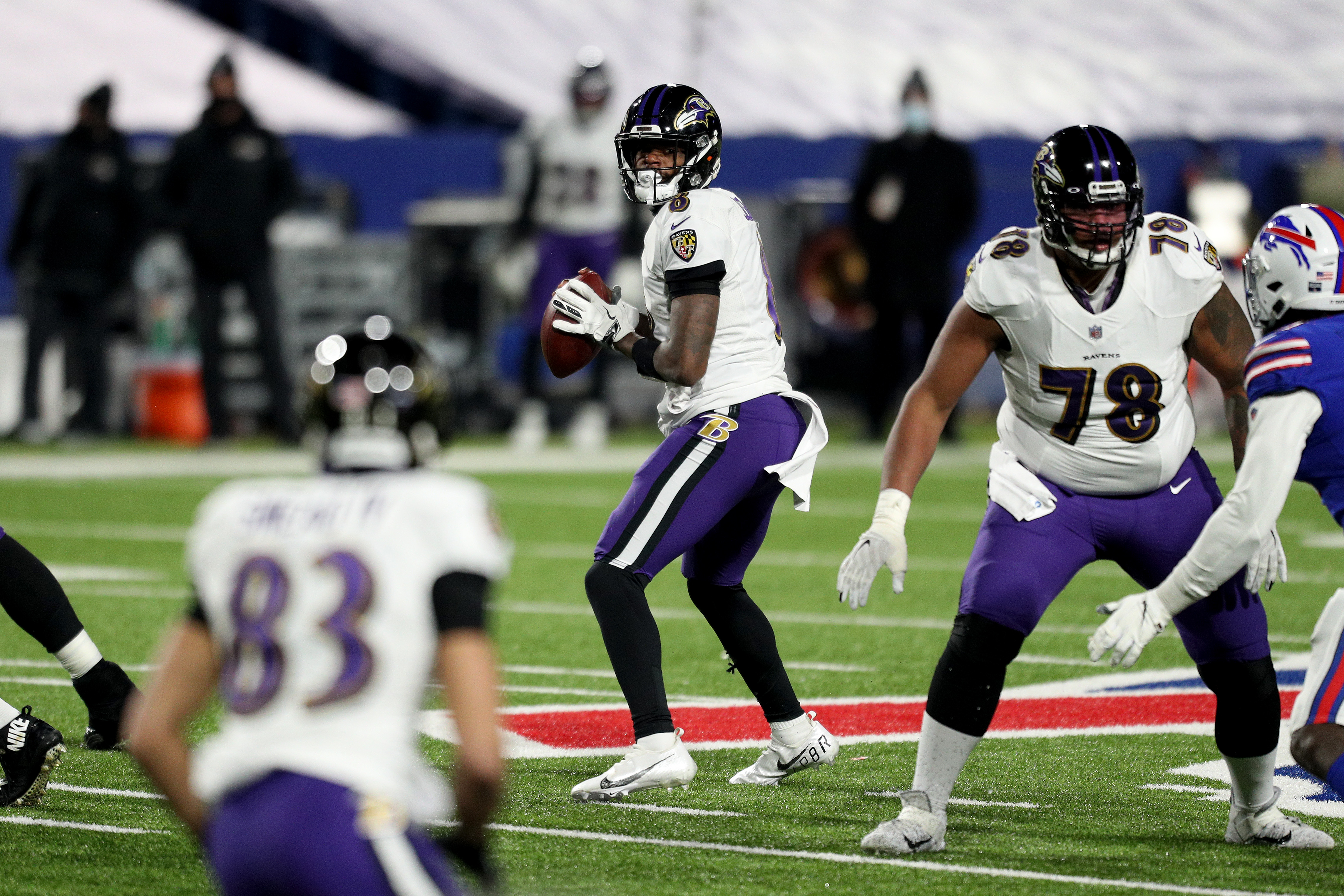 Lamar Jackson #8 of the Baltimore Ravens looks to pass during the third quarter of an AFC Divisional Playoff game against the Buffalo Bills at Bills Stadium on January 16, 2021 in Orchard Park, New York.