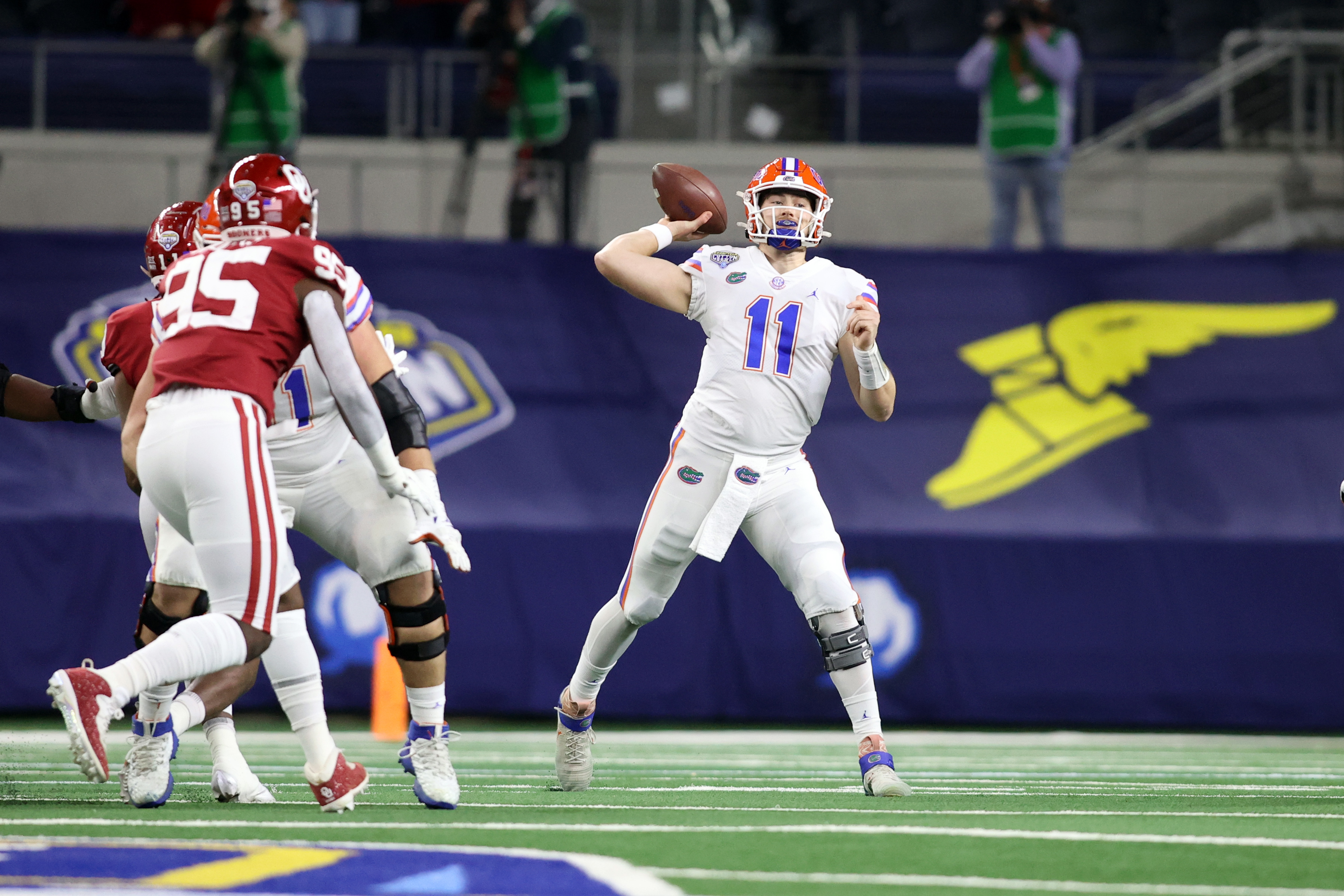 Florida Gators quarterback Kyle Trask (11) throws a pass against the Oklahoma Sooners in the first quarter at ATT Stadium.