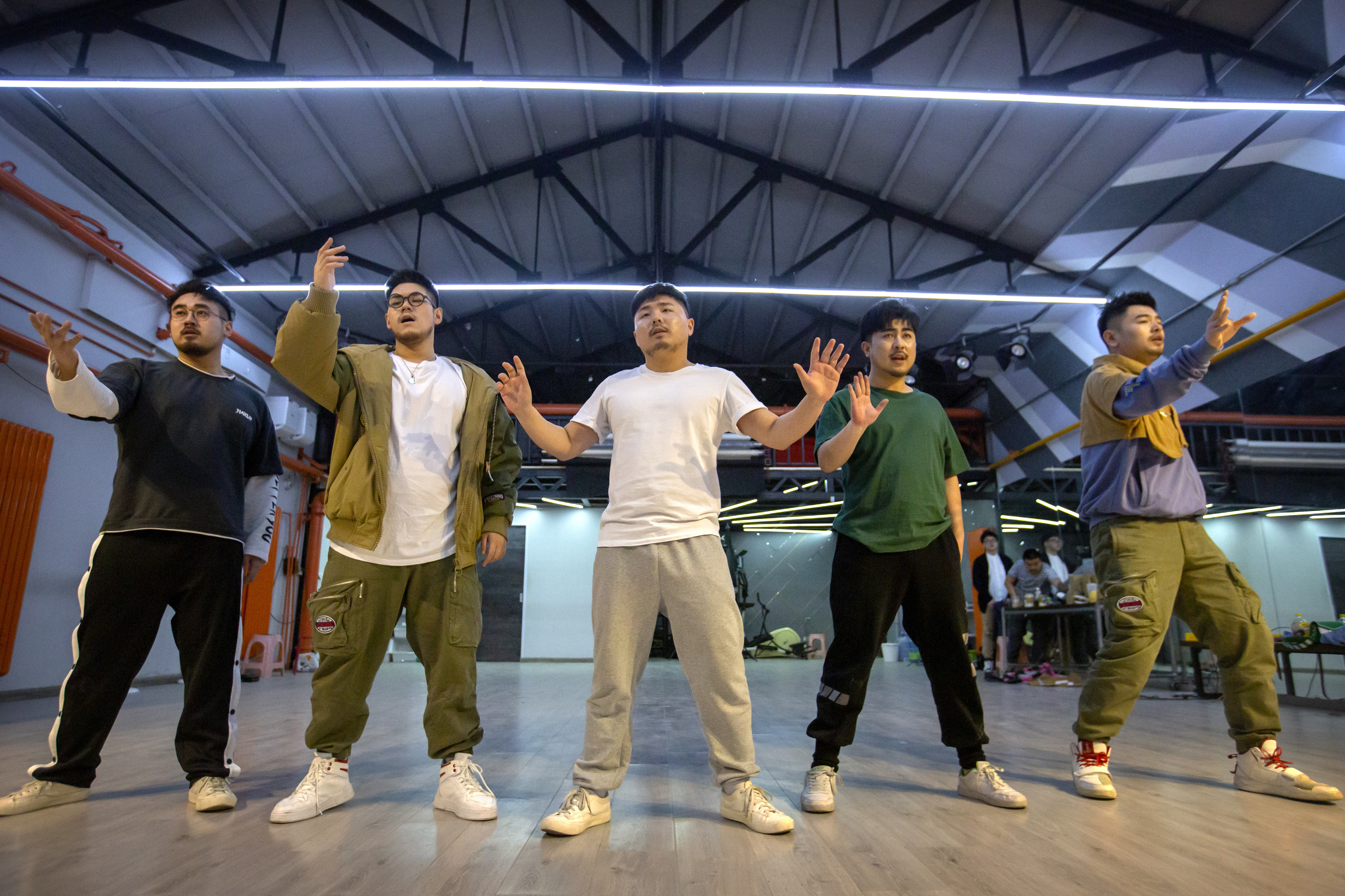 "Members of the Chinese music group Produce Pandas — DING (from left), Husky, Otter, Cass and Mr. 17 — strike a pose while practicing dance choreography during rehearsals in Beijing earlier this month. The groups proudly call themselves ""the first plus-sized boy band in China."""