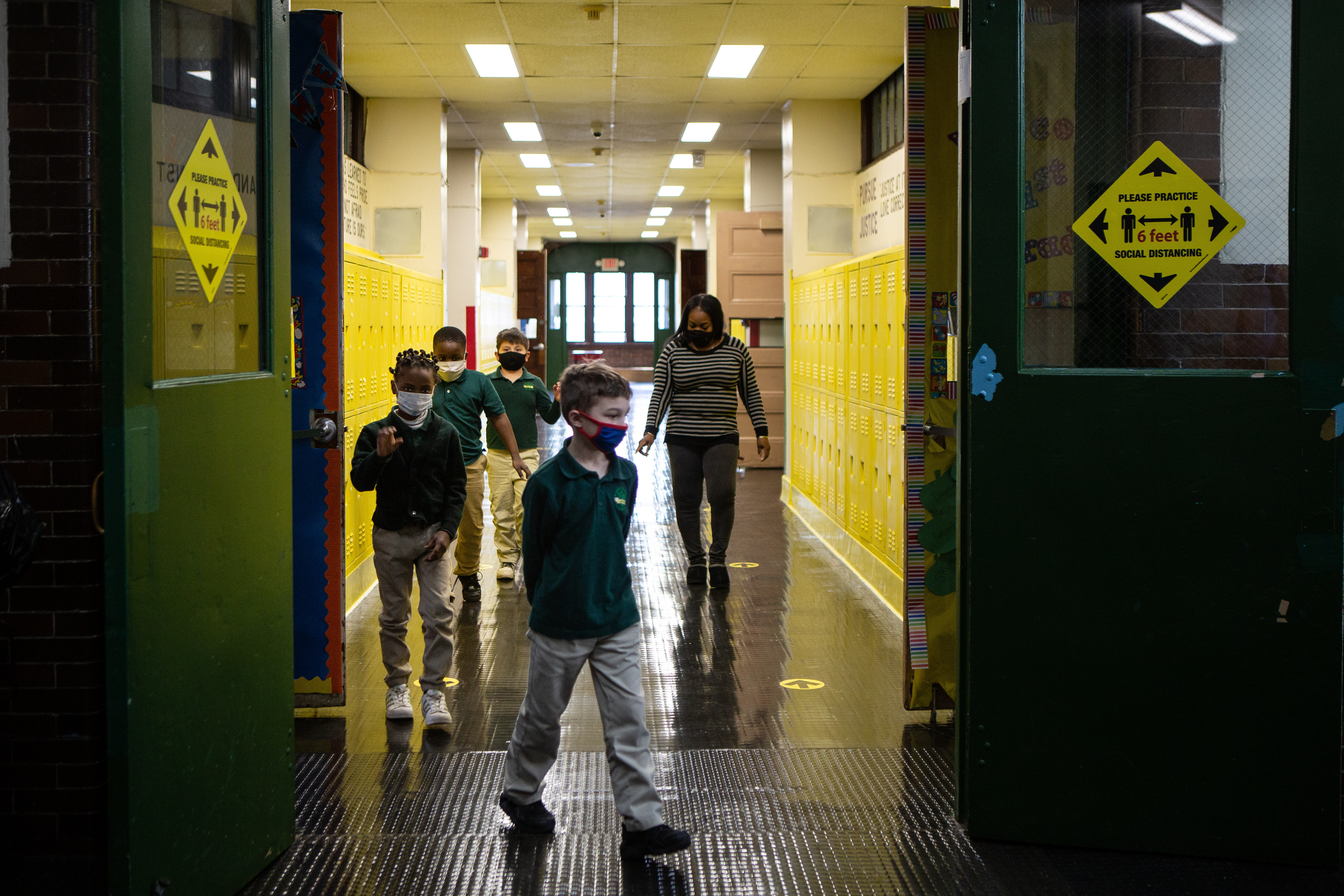 Students walk through the hall at Roseville Community Charter school in Newark, N.J.