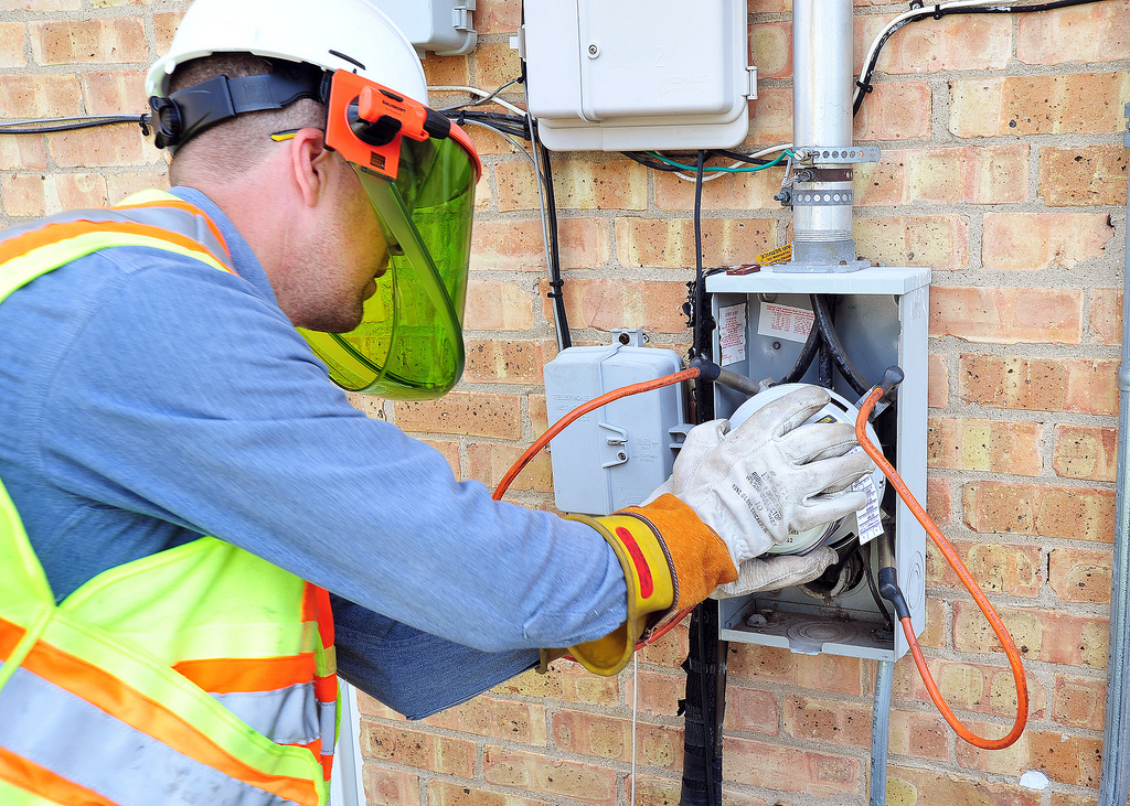 A ComEd worker installs an electric meter.