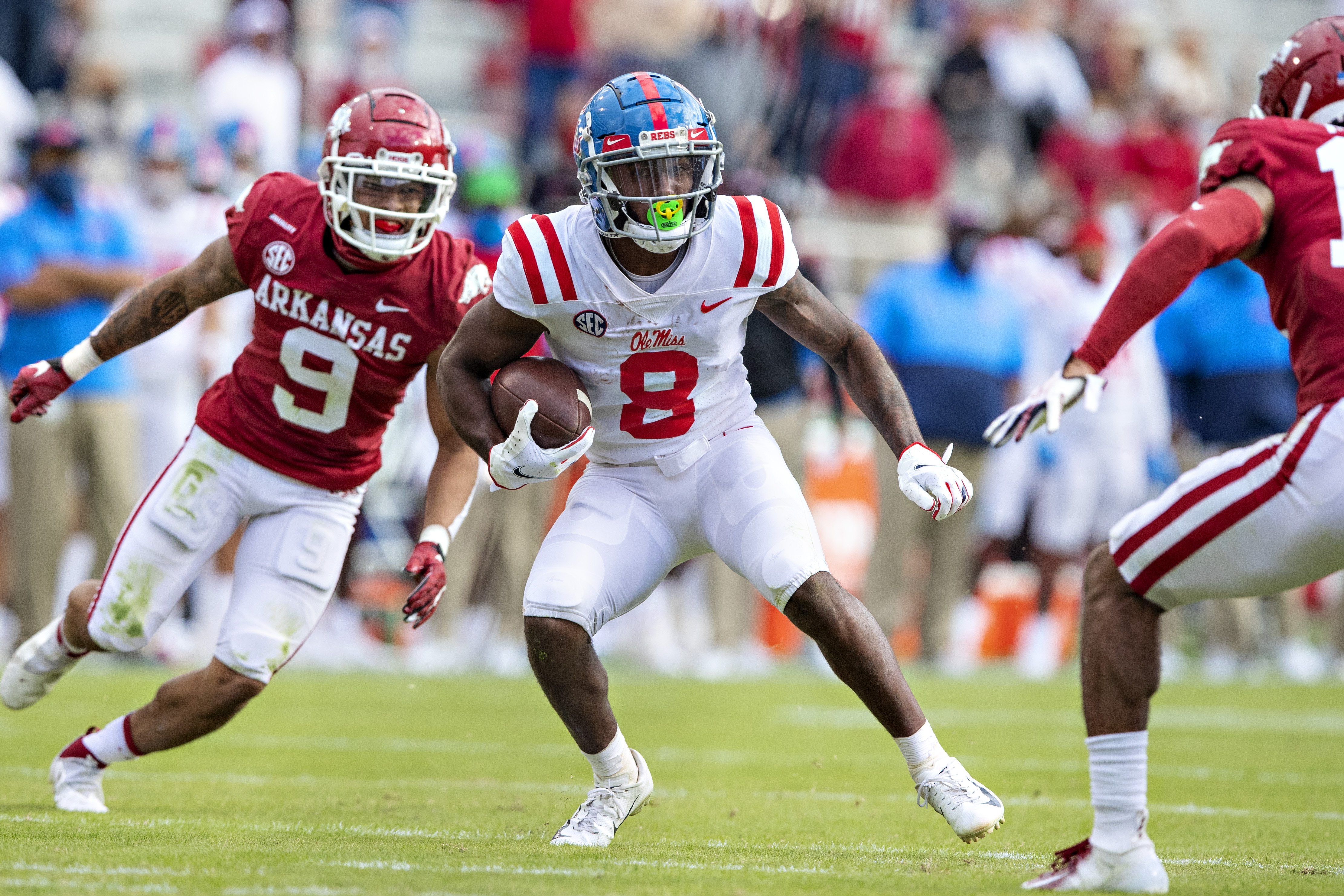 Elijah Moore #8 of the Mississippi Rebels looks for a place to run in the second half of a game against the Arkansas Razorbacks at Razorback Stadium on October 17, 2020 in Fayetteville, Arkansas.