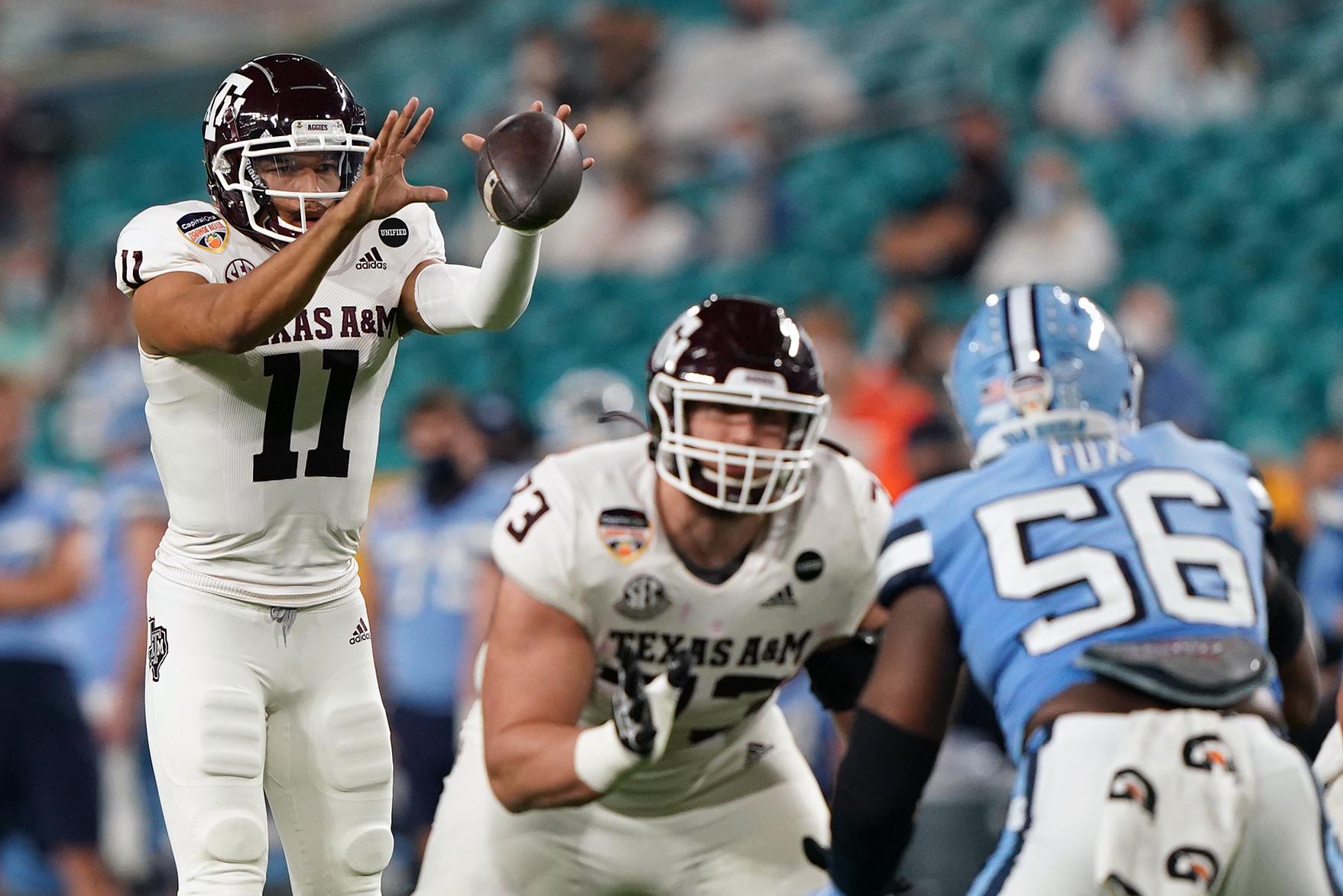 Texas A&M Aggies quarterback Kellen Mond takes the snap during the first half North Carolina Tar Heels at Hard Rock Stadium.