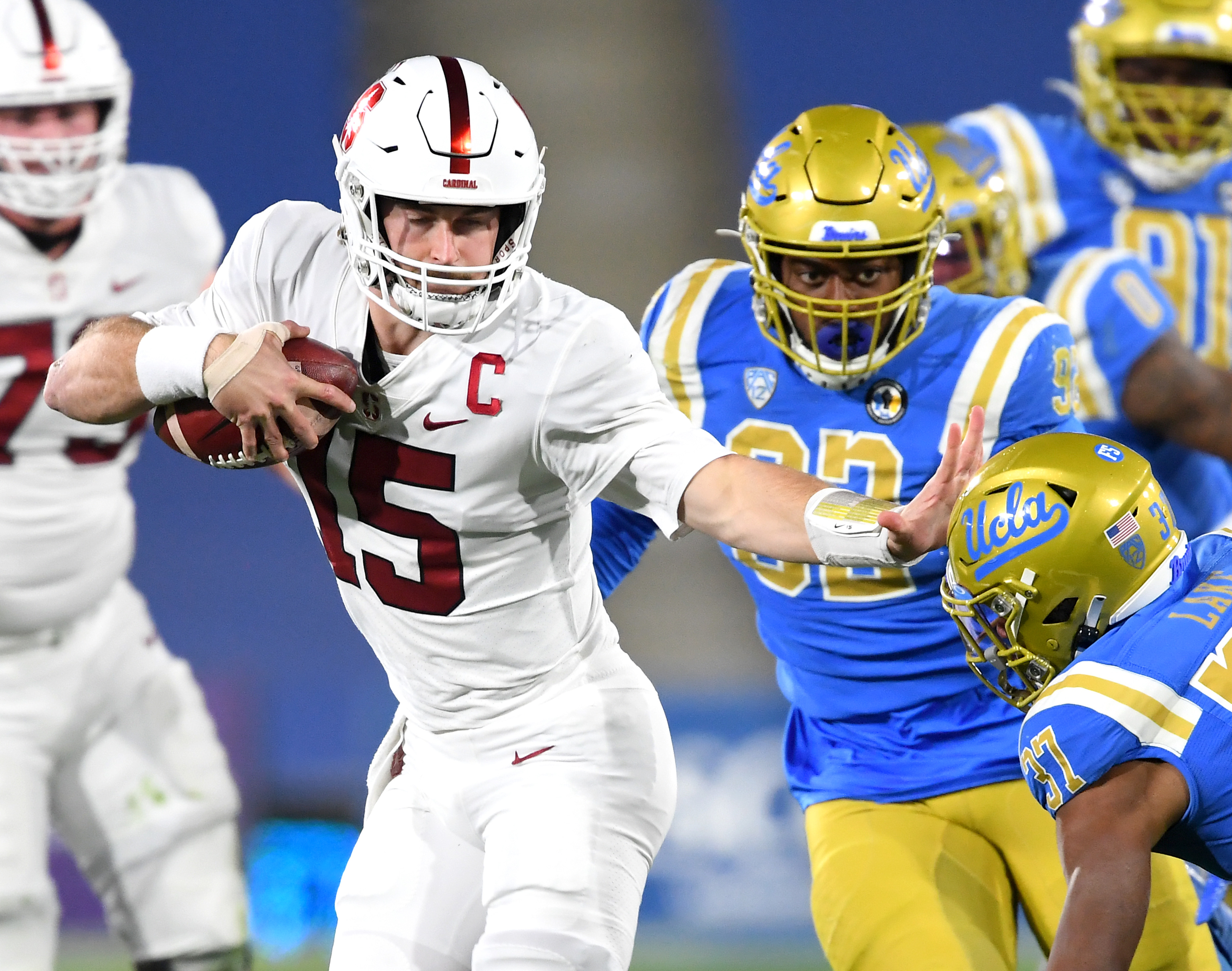 Bruins defensive back Quentin Lake misses a tackle on Stanford Cardinal quarterback Davis Mills as he scrambles for a first down in the first half of the game at the Rose Bowl.