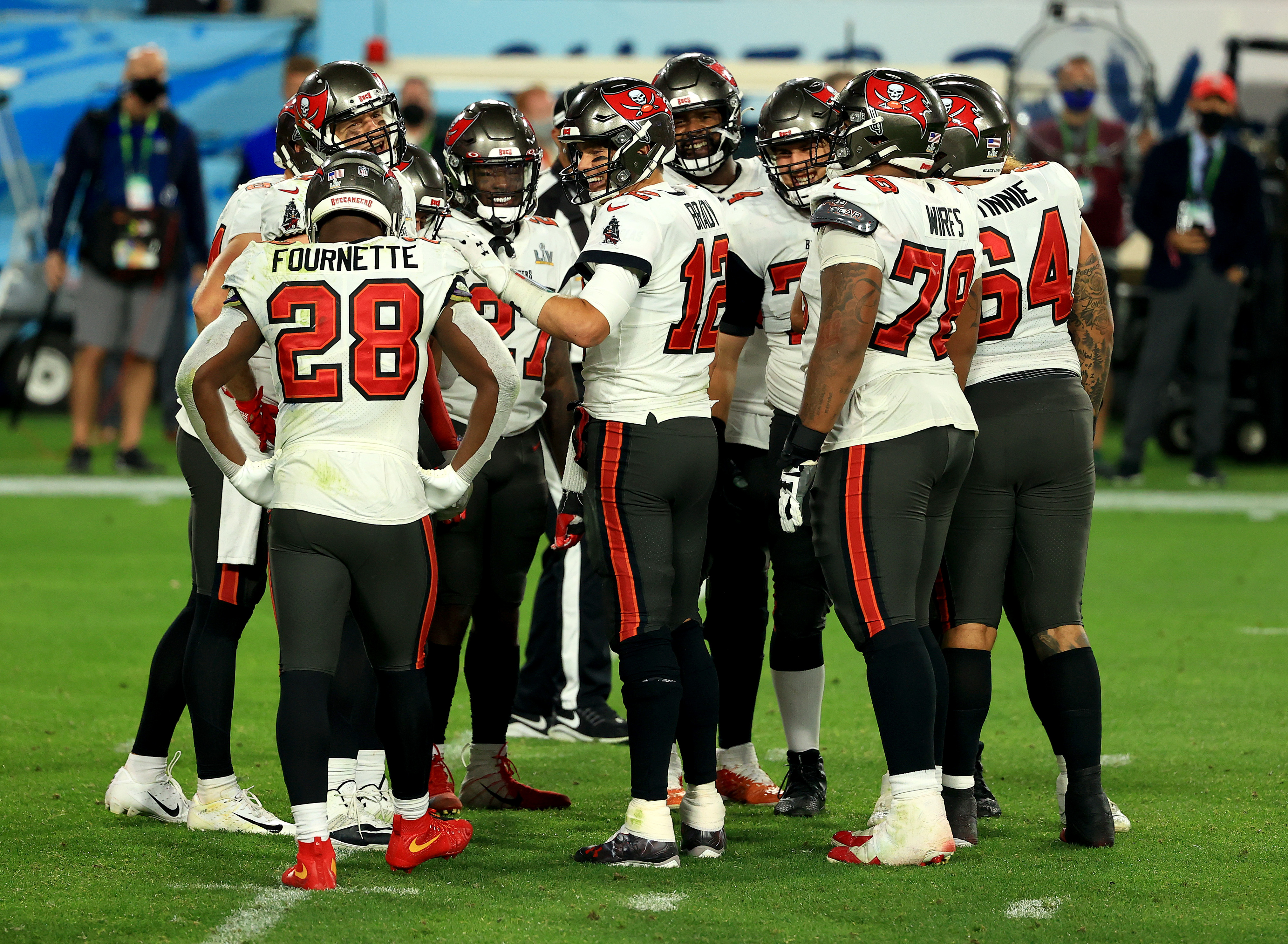 Tom Brady #12 of the Tampa Bay Buccaneers reacts with teammates late in the fourth quarter against the Kansas City Chiefs in Super Bowl LV at Raymond James Stadium on February 07, 2021 in Tampa, Florida.